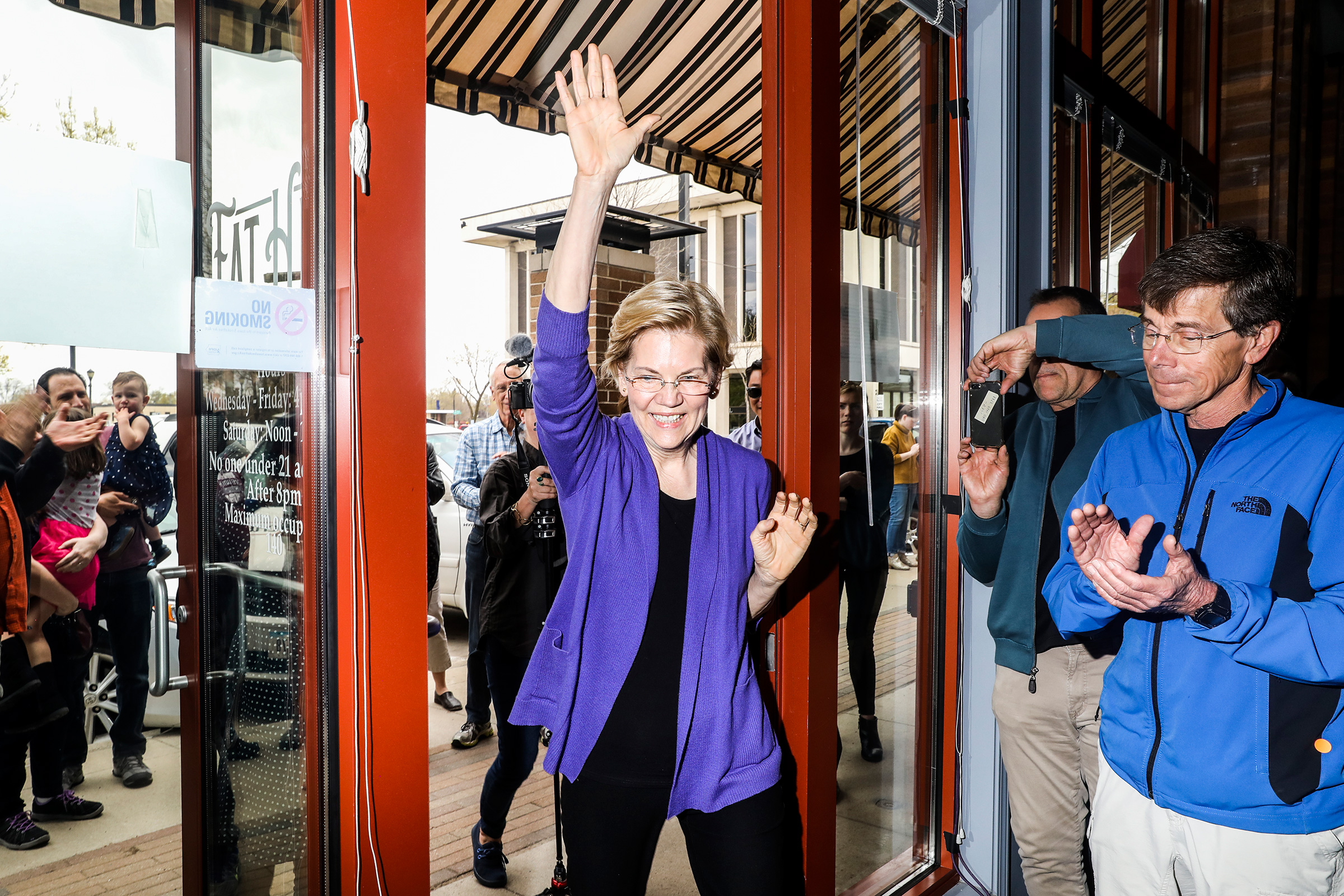 Warren walks into an event at Fat Hill Brewing in Mason City on May 4.