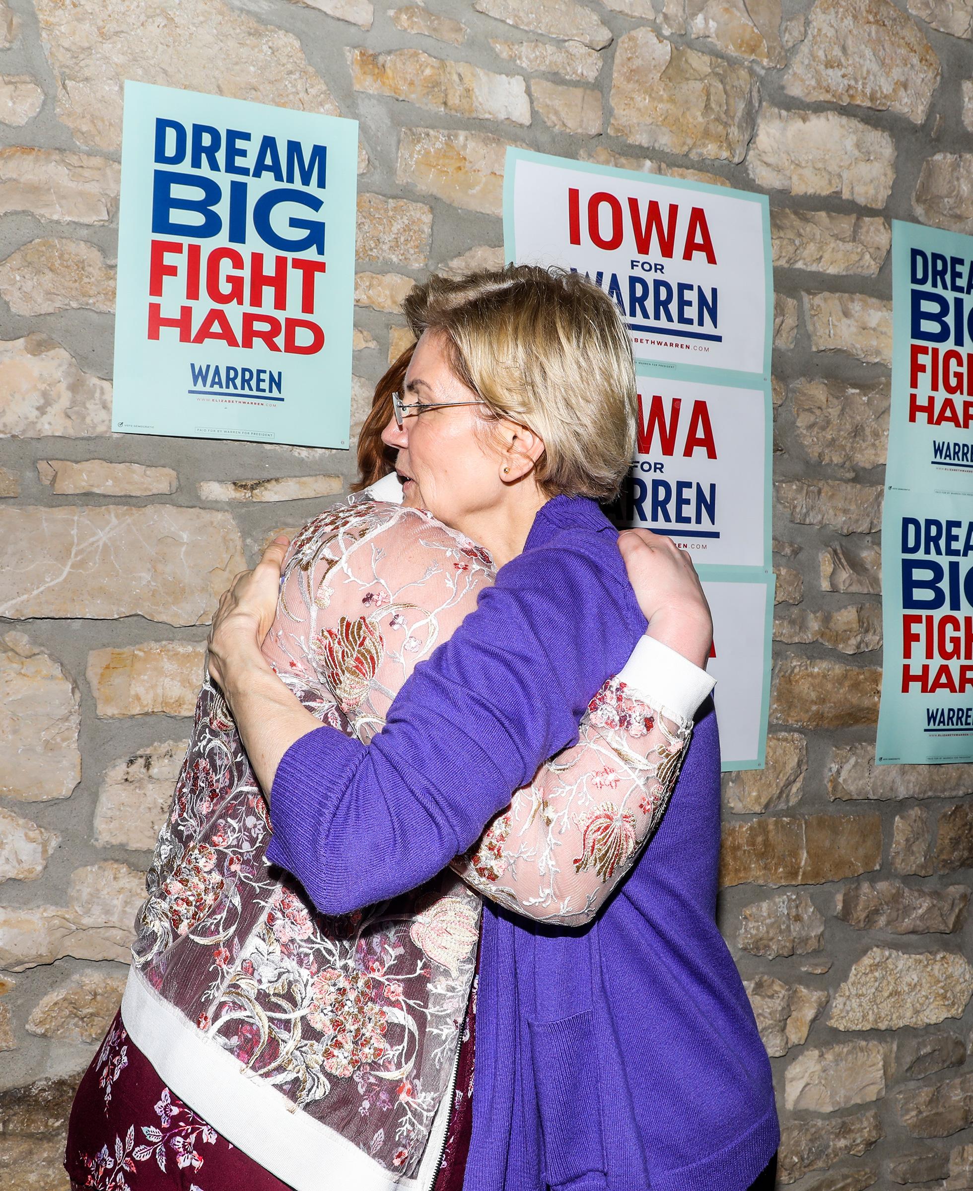 Warren greets a fan in Mason City on May 4.