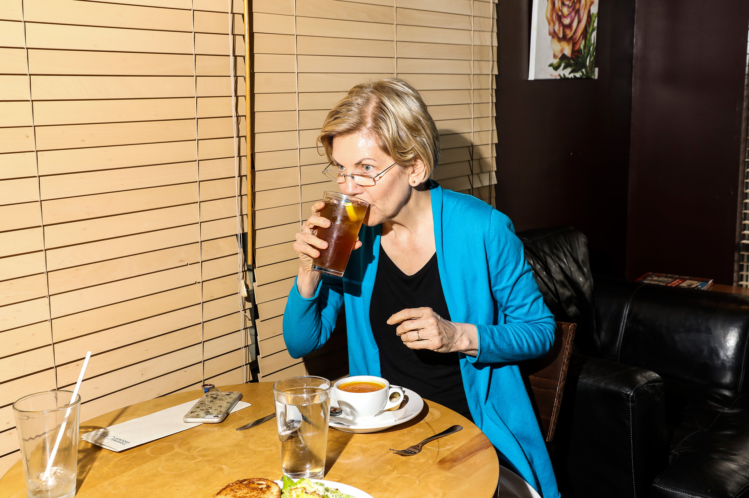 Warren breaks for lunch between campaign events at the Stomping Grounds Cafe in Ames, Iowa.