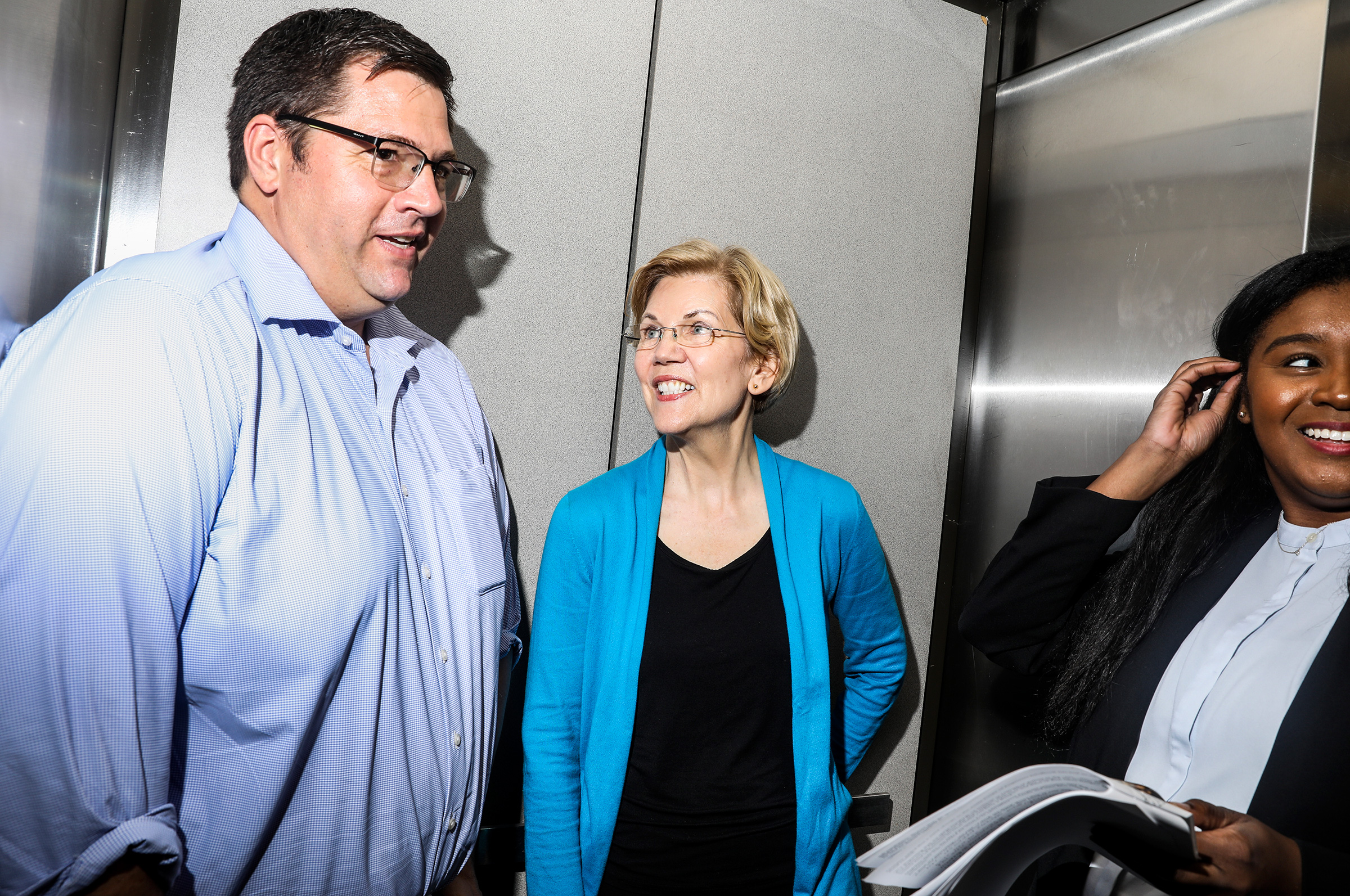 Warren and her son, Alex, in the elevator on the way up to an organizing event at Iowa State University on May 3.