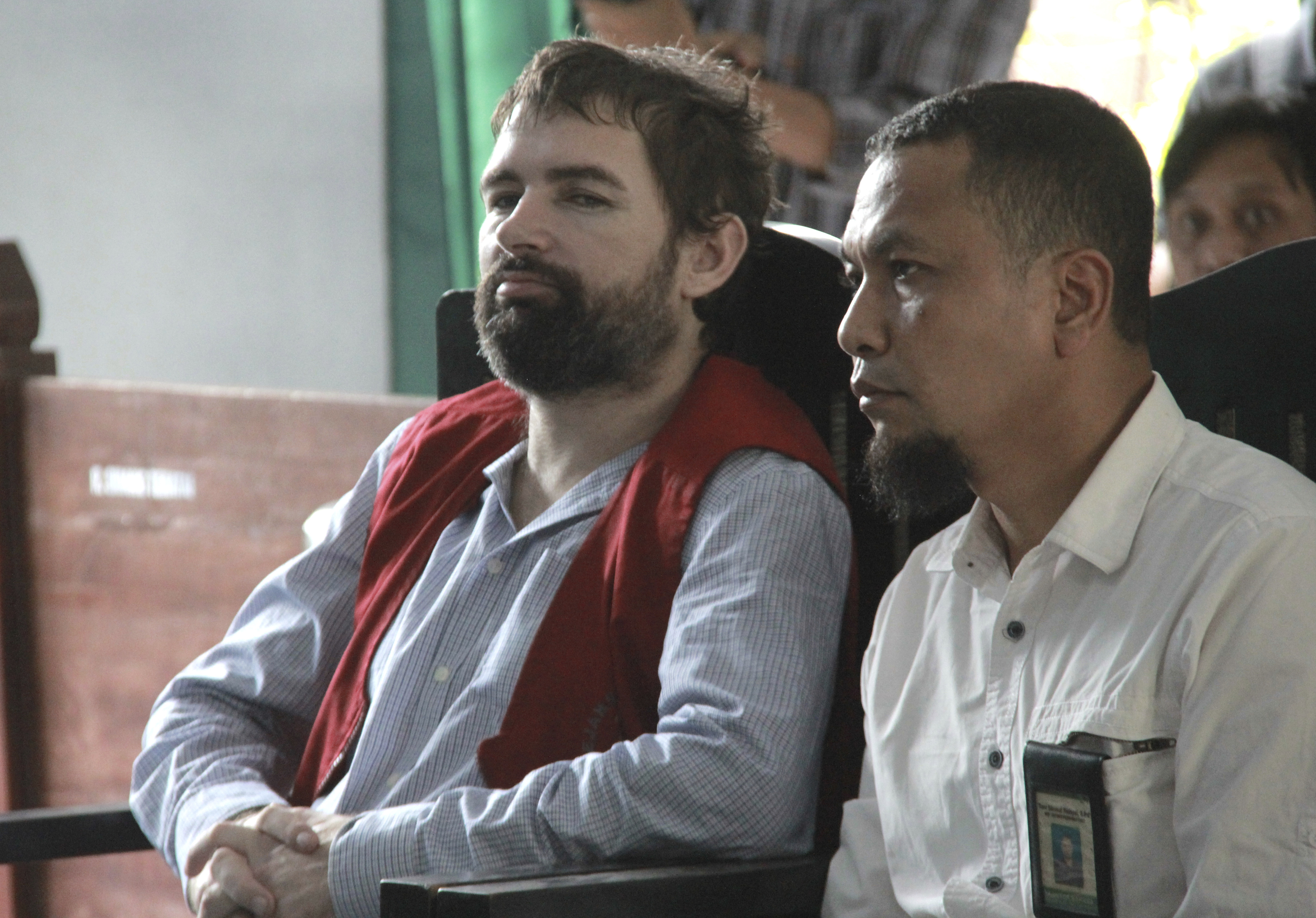 French national Felix Dorfin, left, is accompanied by an interpreter during his sentencing hearing at a district court in Mataram, Lombok Island, Indonesia, on May 20, 2019.