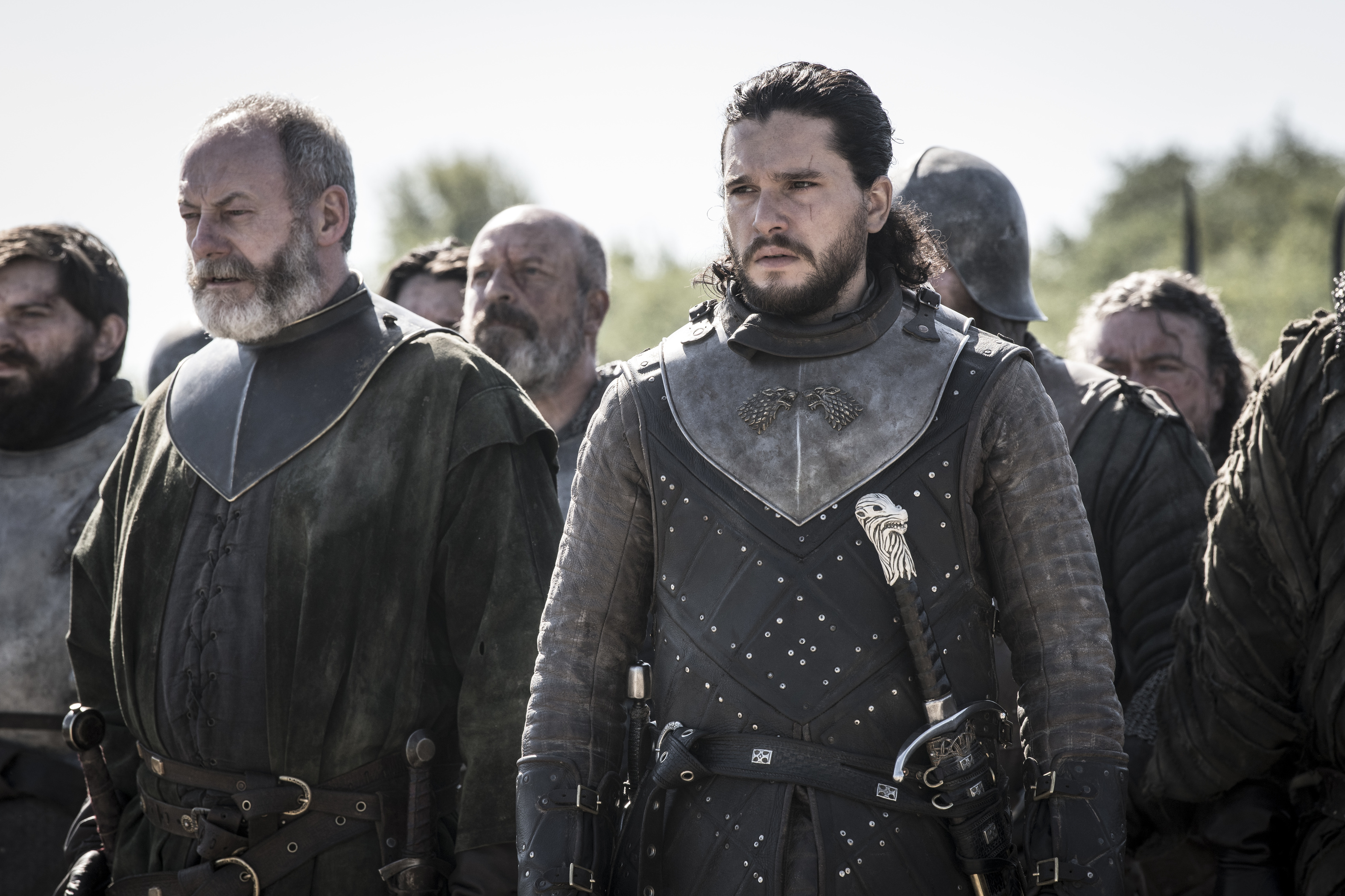 Liam Cunningham as Davos Seaworth and Kit Harington as Jon Snow.