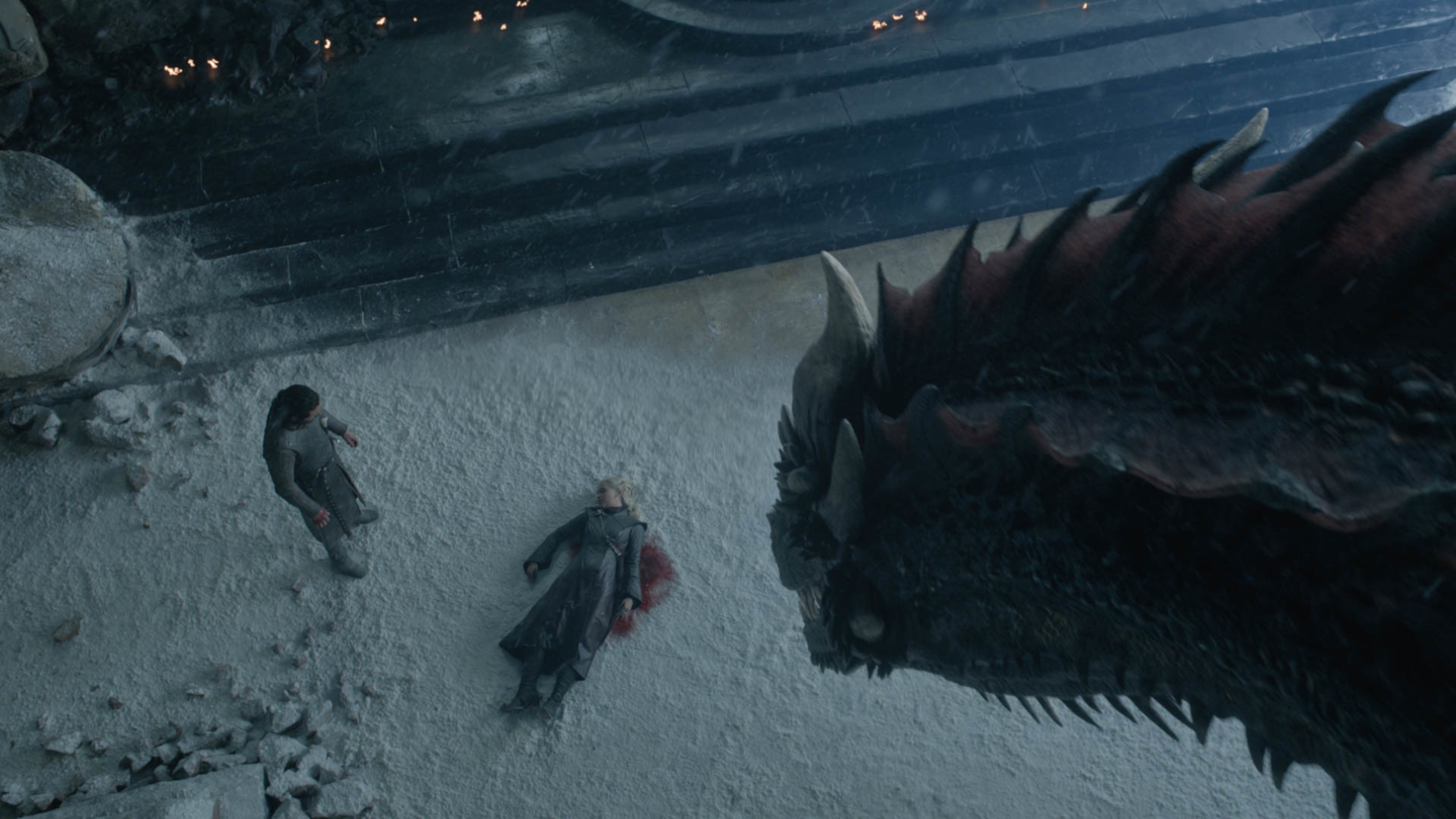 Aerial shot of Dragon looking at Jon Snow over Daenerys' dead body on Game of Thrones' series finale