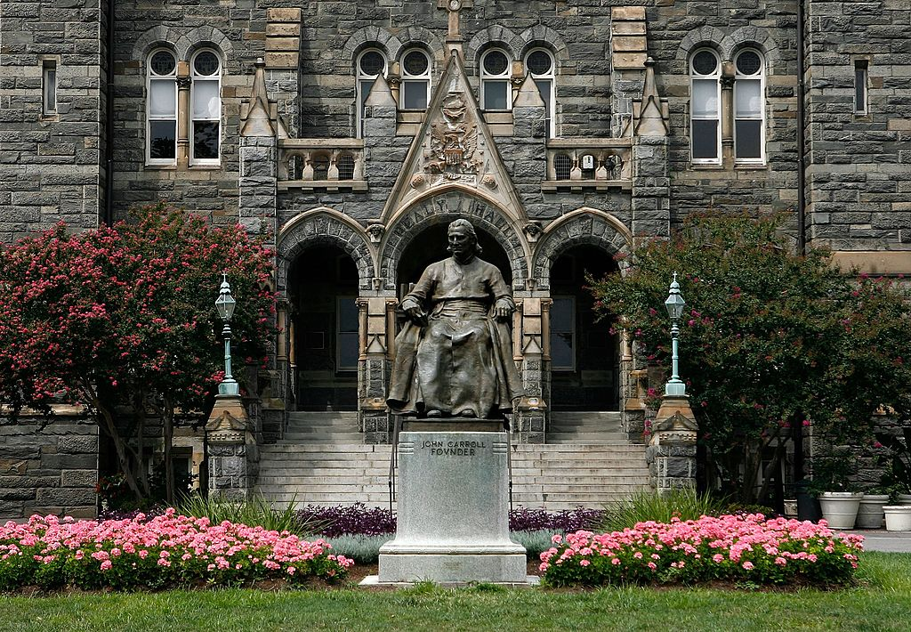 A statue of John Carroll, founder of Georgetown University, sits before Healy Hall on the school's campus on August 15, 2006 in Washington, DC. A Georgetown University student sued to block the school from punishing him because his father paid off a tennis coach to get into college.