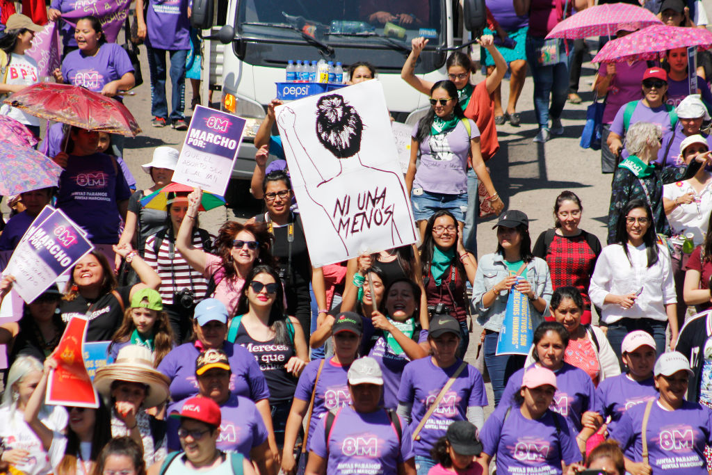 Salvadoran women walk showing banners during a demonstration as part of the International Women's Day on March 8, 2019 in San Salvador, El Salvador.