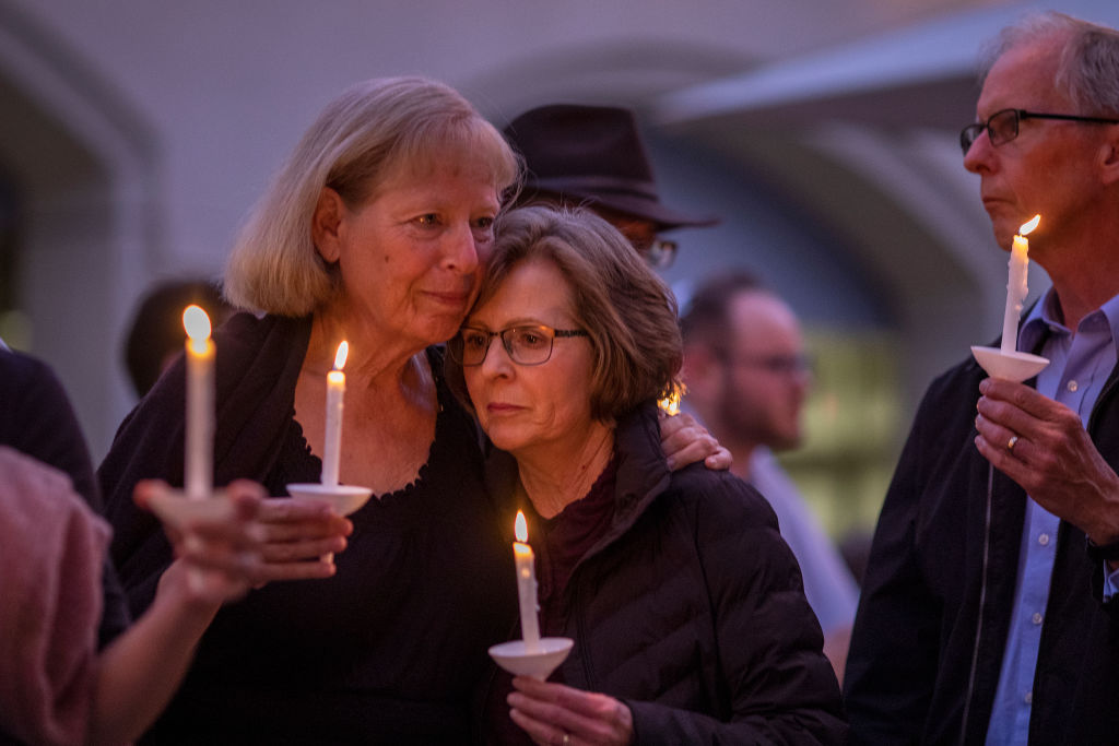 People attend a prayer and candlelight vigil at Rancho Bernardo Community Presbyterian Church on April 27, 2019 in Poway, California.
