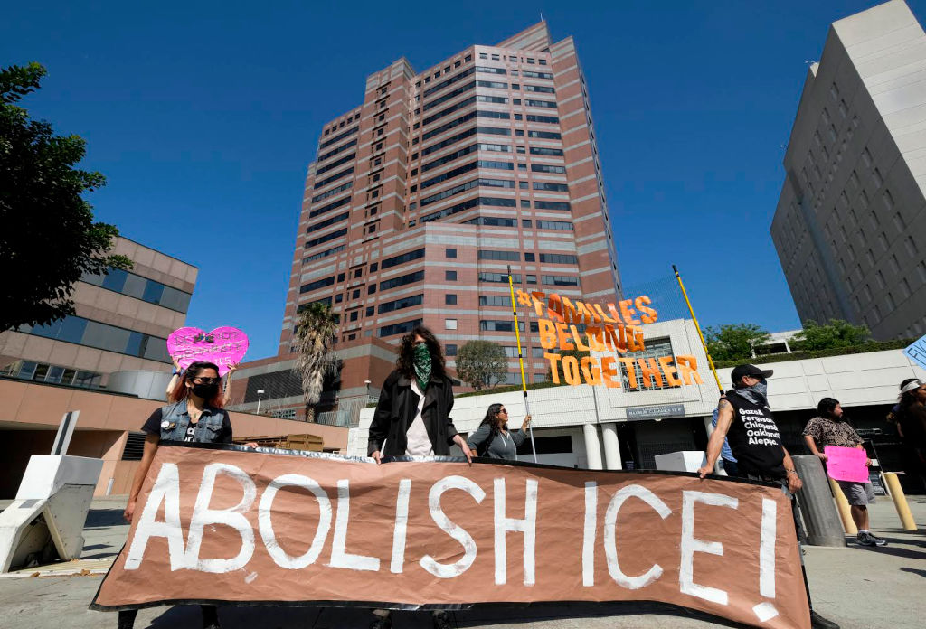 People protest in front of a detention center of U.S. Immigration and Customs Enforcement in downtown Los Angeles on July 2, 2018.