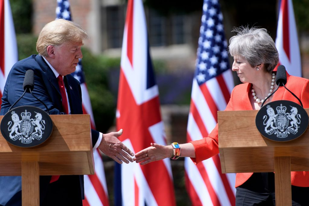 US President Donald Trump and Britain's Prime Minister Theresa May shake hands during a joint press conference following their meeting at Chequers, the prime minister's country residence, near Ellesborough, northwest of London on July 13, 2018.