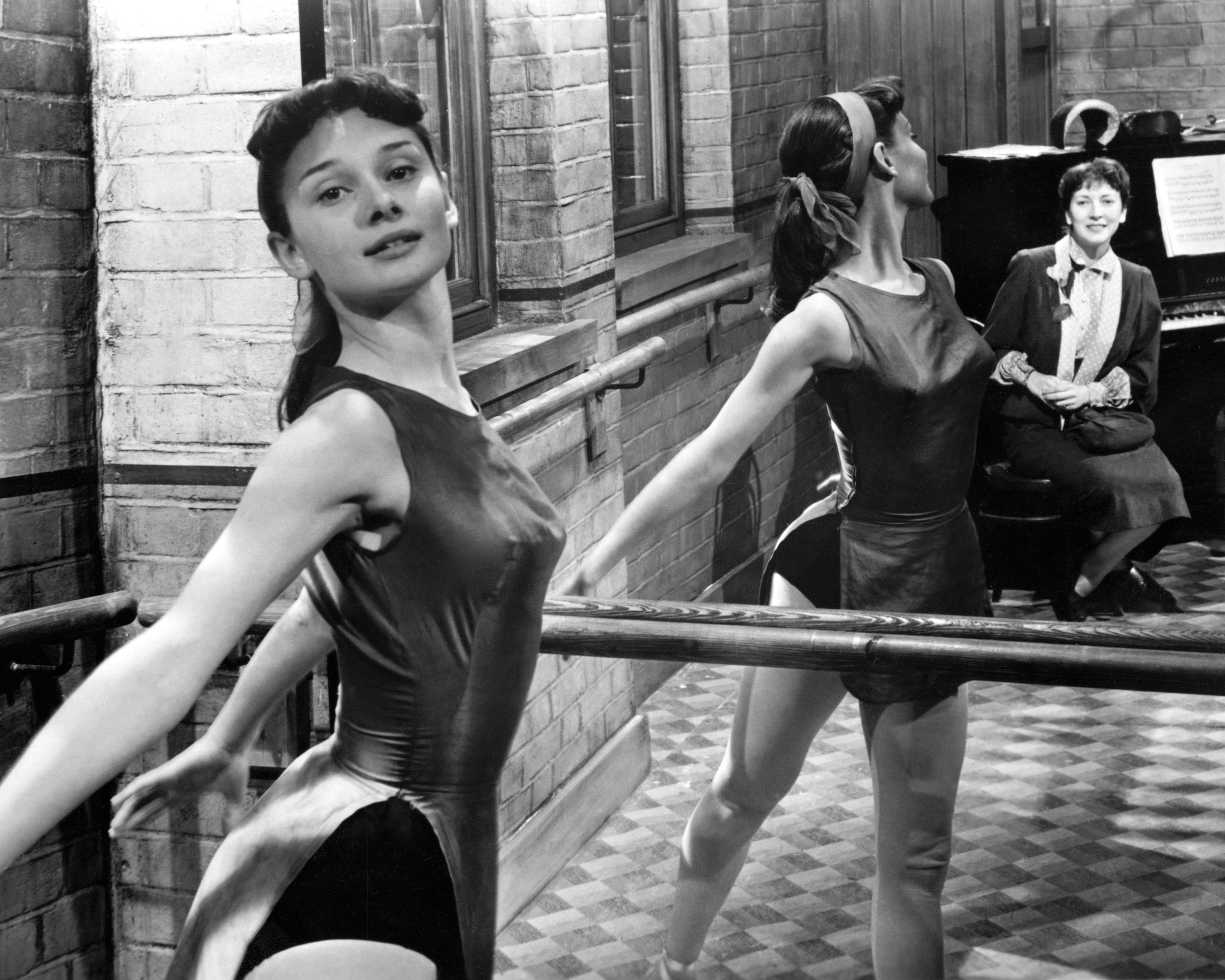 Actor and dancer Audrey Hepburn rehearsing at the barre, circa 1950.