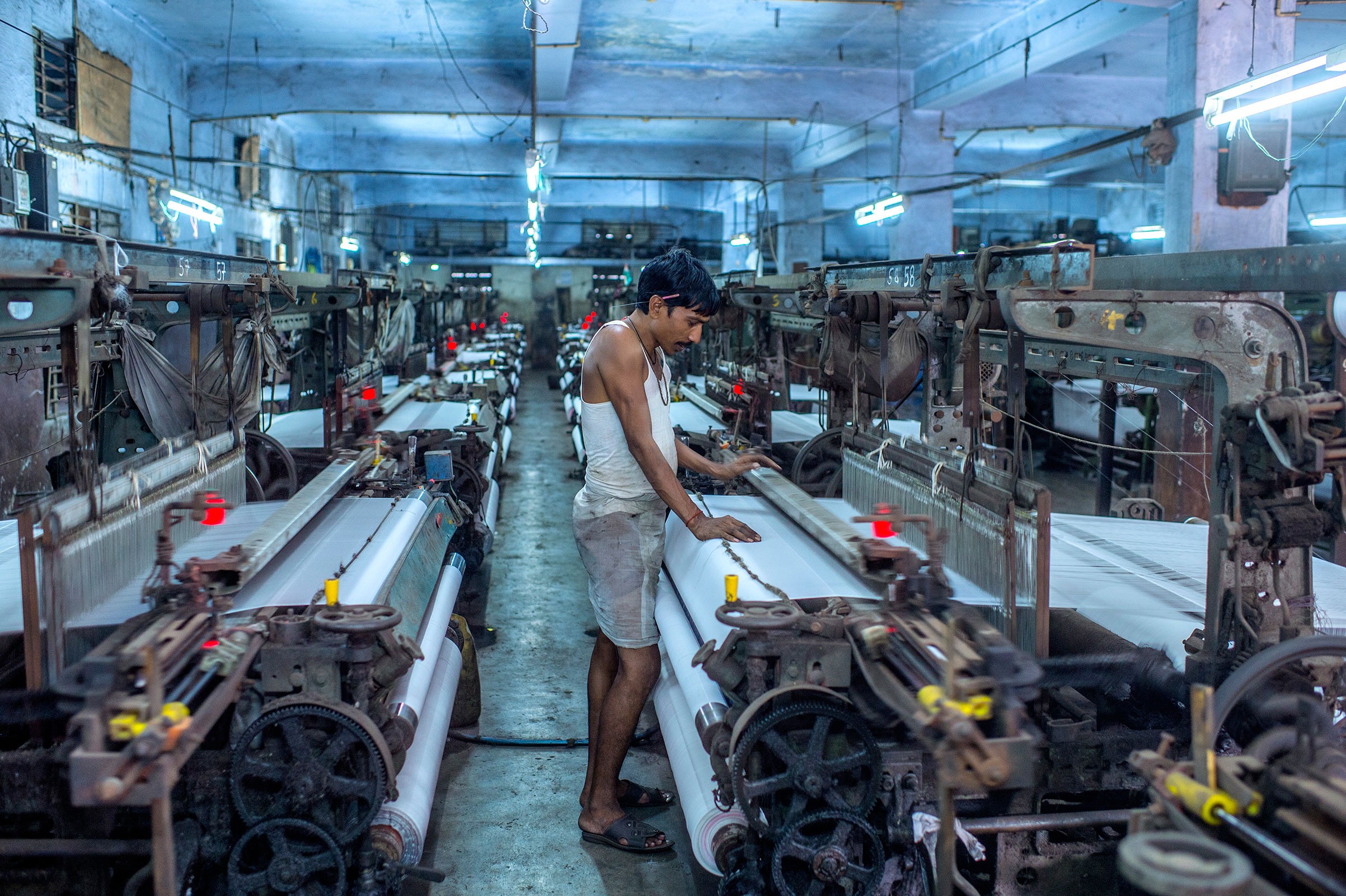 Umakant Sharma works the looms in Surat, India