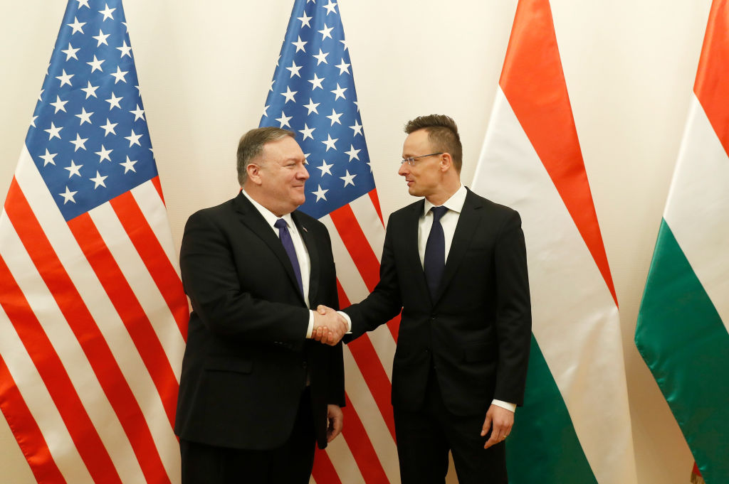 U.S. Secretary of State Mike Pompeo shakes hands with Hungarian Foreign Minister Peter Szijjarto on February 11, 2019 in Budapest, Hungary.