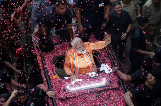 Modi during a road show in Varanasi, in the northern state of Uttar Pradesh, on April 25