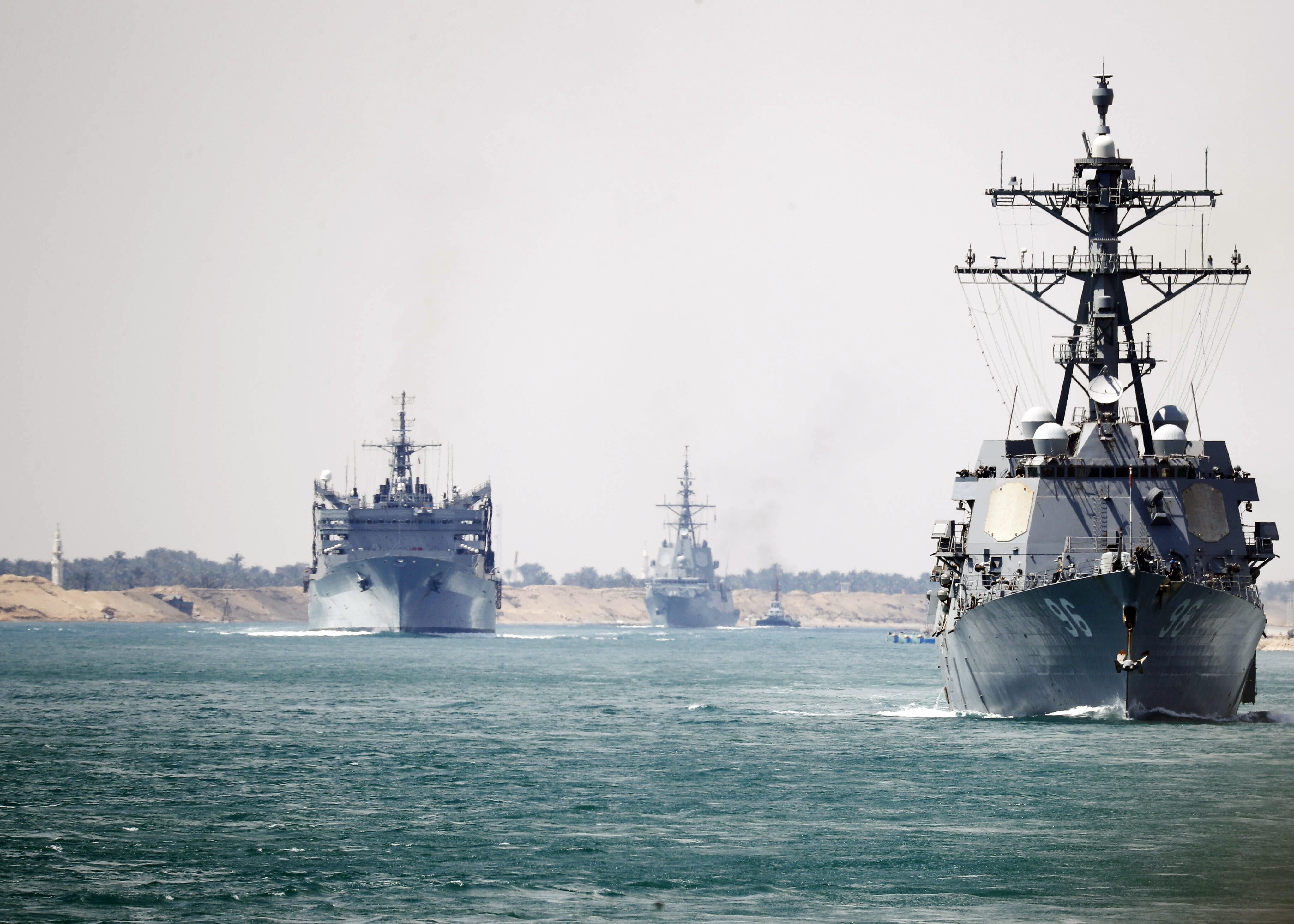 In this photo provided by the U.S. Navy, the Abraham Lincoln Carrier Strike Group transits the Suez Canal, Thursday, May 9, 2019. The Abraham Lincoln Carrier Strike Group is deployed to the U.S. Central Command area of responsibility. With Abraham Lincoln as the flagship, deployed strike group assets include staffs, ships and aircraft of Carrier Strike Group 12, Destroyer Squadron 2, USS Leyte Gulf and Carrier Air Wing 7, as well as the Spanish navy Alvaro de Bazan-class frigate ESPS Mendez Nunez. (Petty Officer 3rd Class Darion Chanelle Triplett/U.S. Navy via AP)