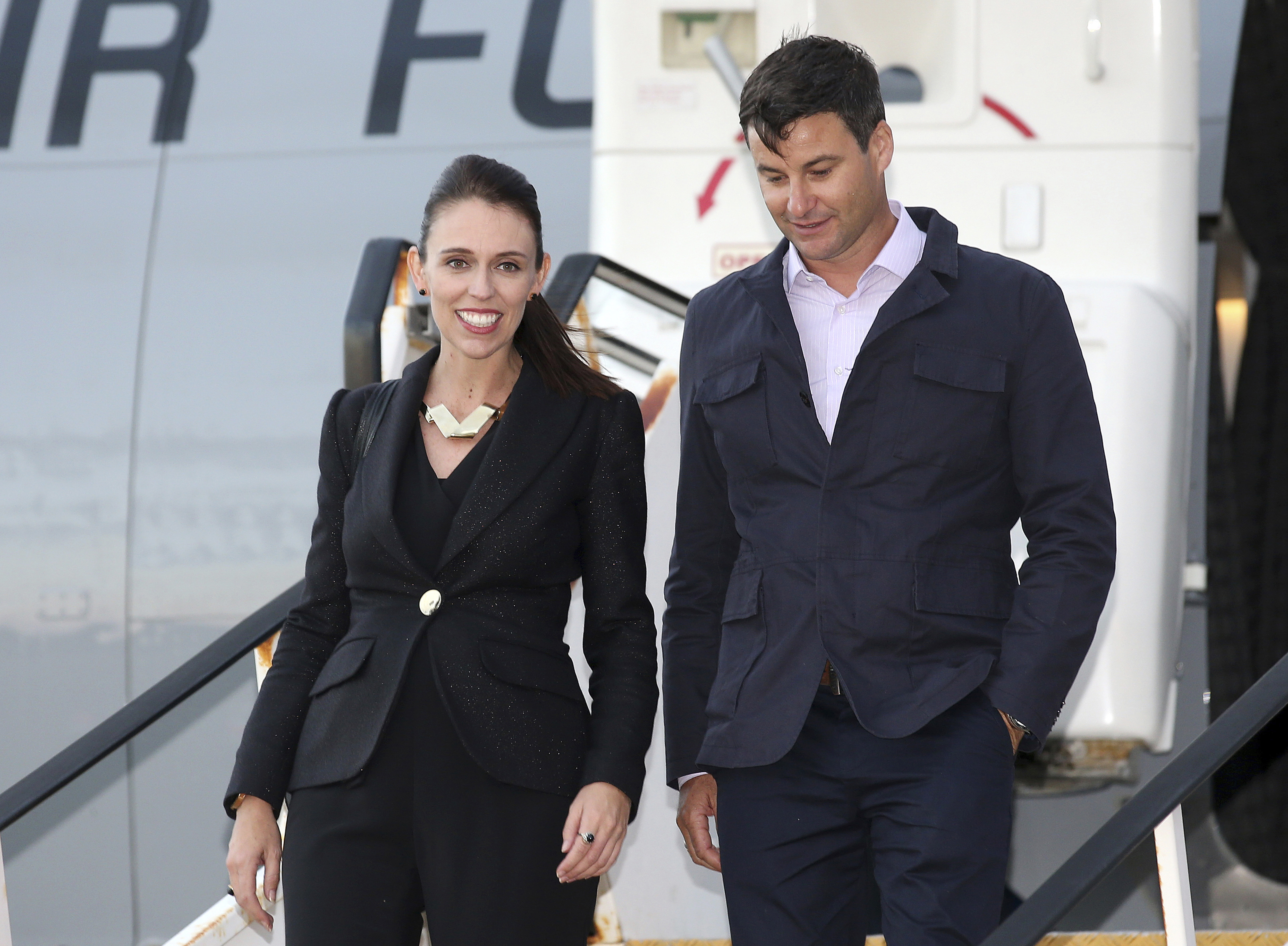 New Zealand Prime Minister Jacinda Ardern, left, and her partner Clarke Gayford arrive in Sydney on March 1, 2018.