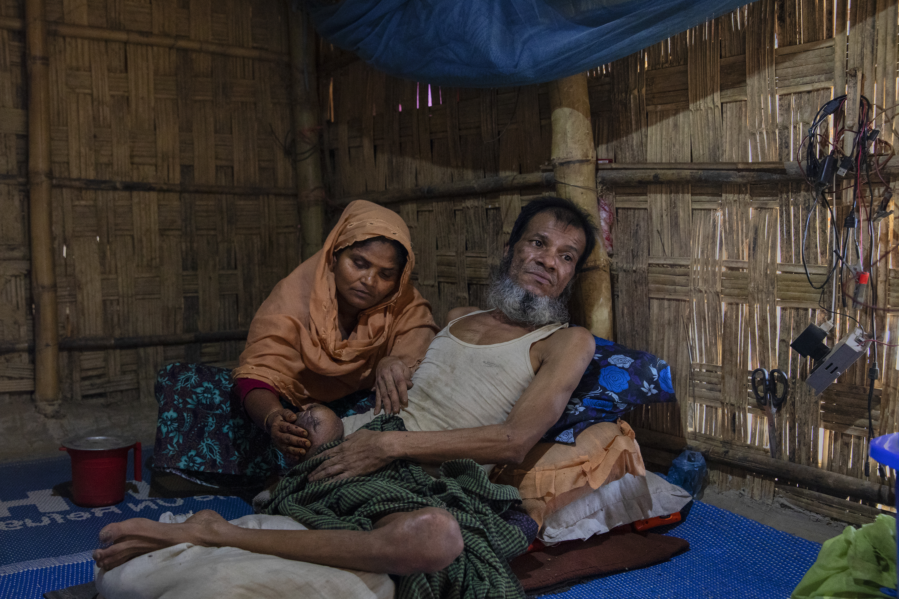Inan Hossein, with his wife Halema Khatun, lost his leg to a gunshot from a government soldier in Myanmar.
