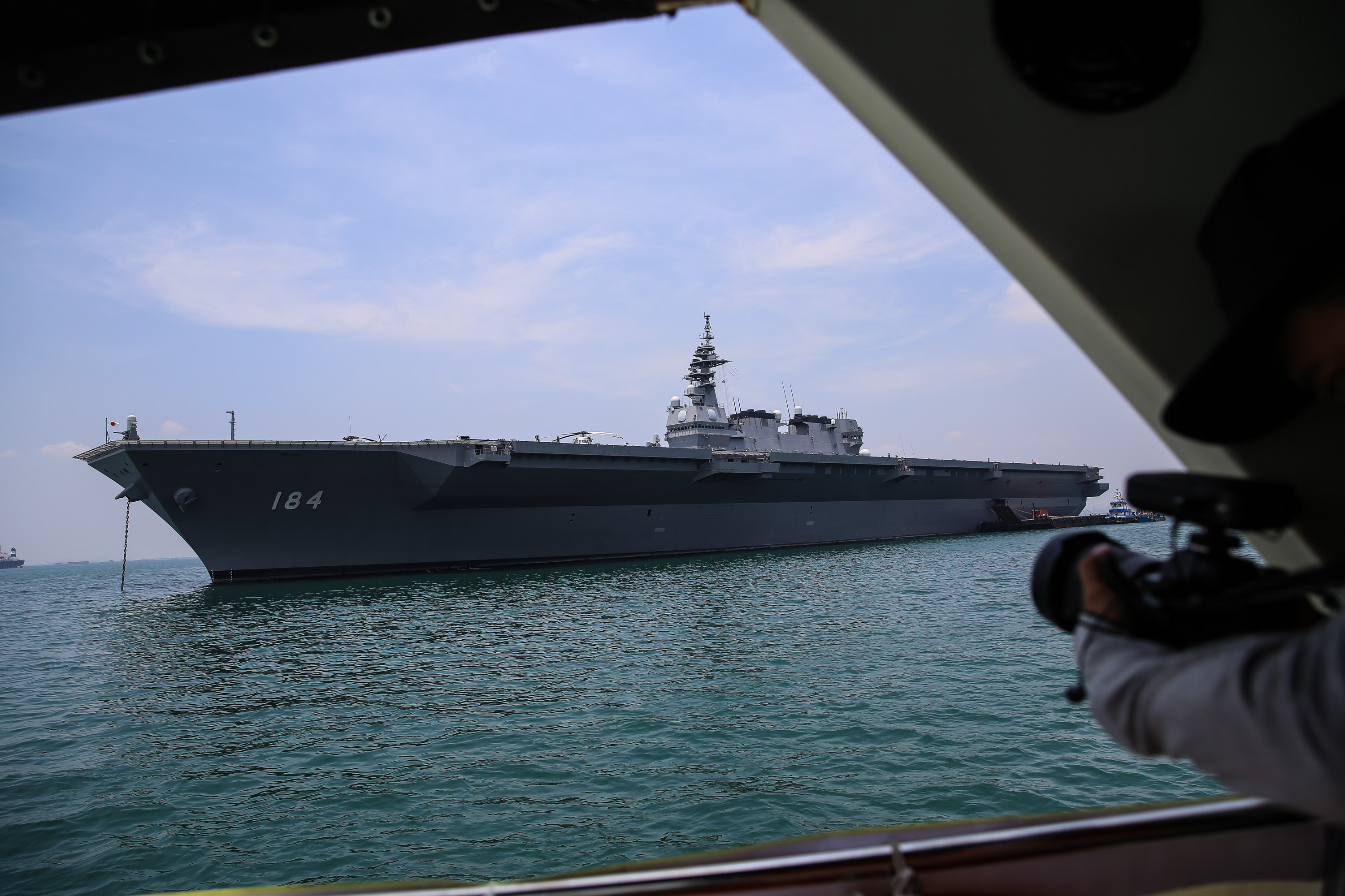 Ship JS KAGA DDH-184 in the Izumo class of the Japan Maritime Self-Defense Force (MSDF), as it arrives at Tanjung Priok port in Jakarta, Indonesia on Tuesday, September 18, 2018. The Japanese flotillas visit is Japans way to enhance its operational capability, promote cooperation, and facilitate interoperability with partner navies in South Asia and Southeast Asia. (Photo by Andrew Lotulung/NurPhoto via Getty Images)