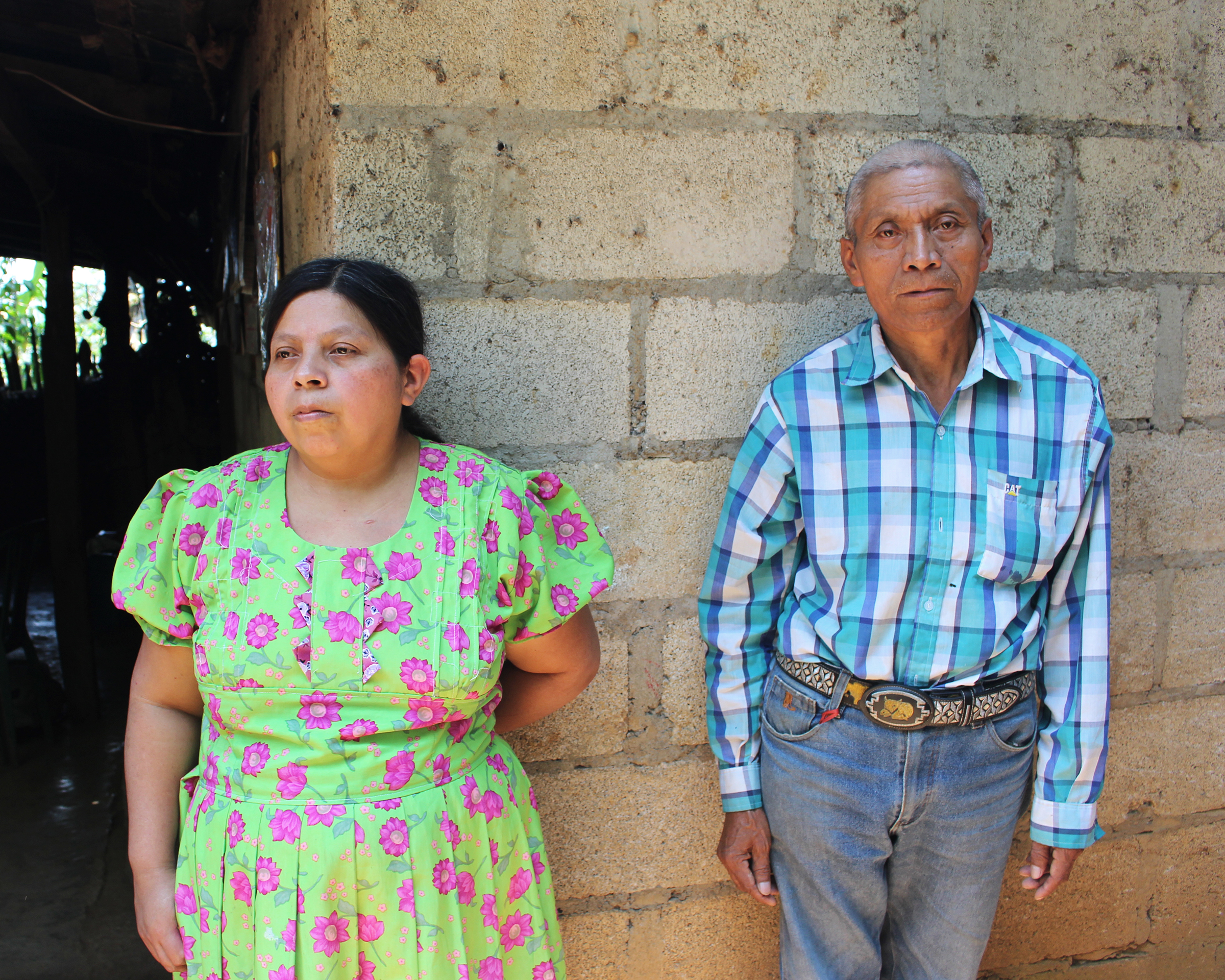 Juan de León Gutiérrez's parents, Tránsito Gutiérrez and Tanerjo de Léon, outside their home in El Tesoro, Guatemala.
