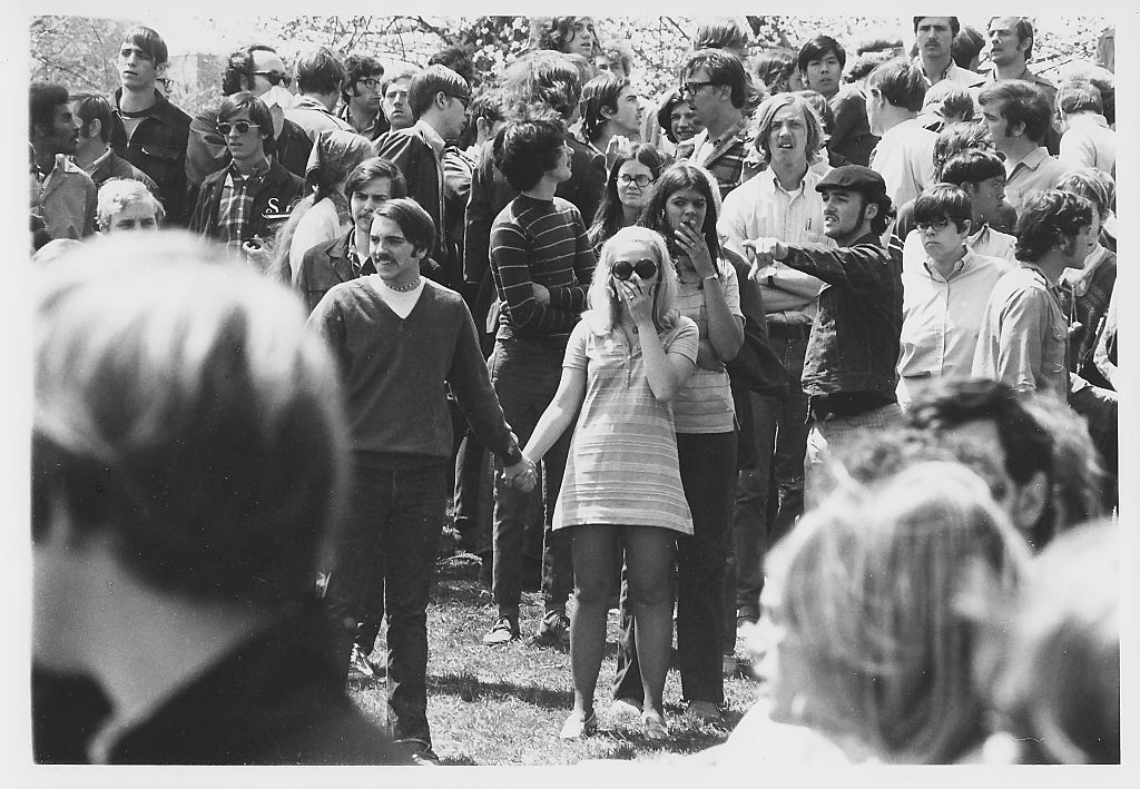 On Blanket Hill, Kent State University students, several with hands over their mouths, stare in the aftermath of the Ohio National Guard having opened fire on their antiwar demonstration, Kent, Ohio, May 4, 1970.