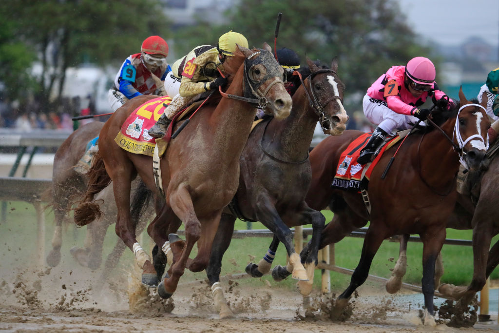 Country House #20, ridden by jockey Flavien Prat, War of Will #1, ridden by jockey Tyler Gaffalione , and Maximum Security #7, ridden by jockey Luis Saez fight for position in the final turn during the 145th running of the Kentucky Derby at Churchill Downs on May 04, 2019 in Louisville, Kentucky.