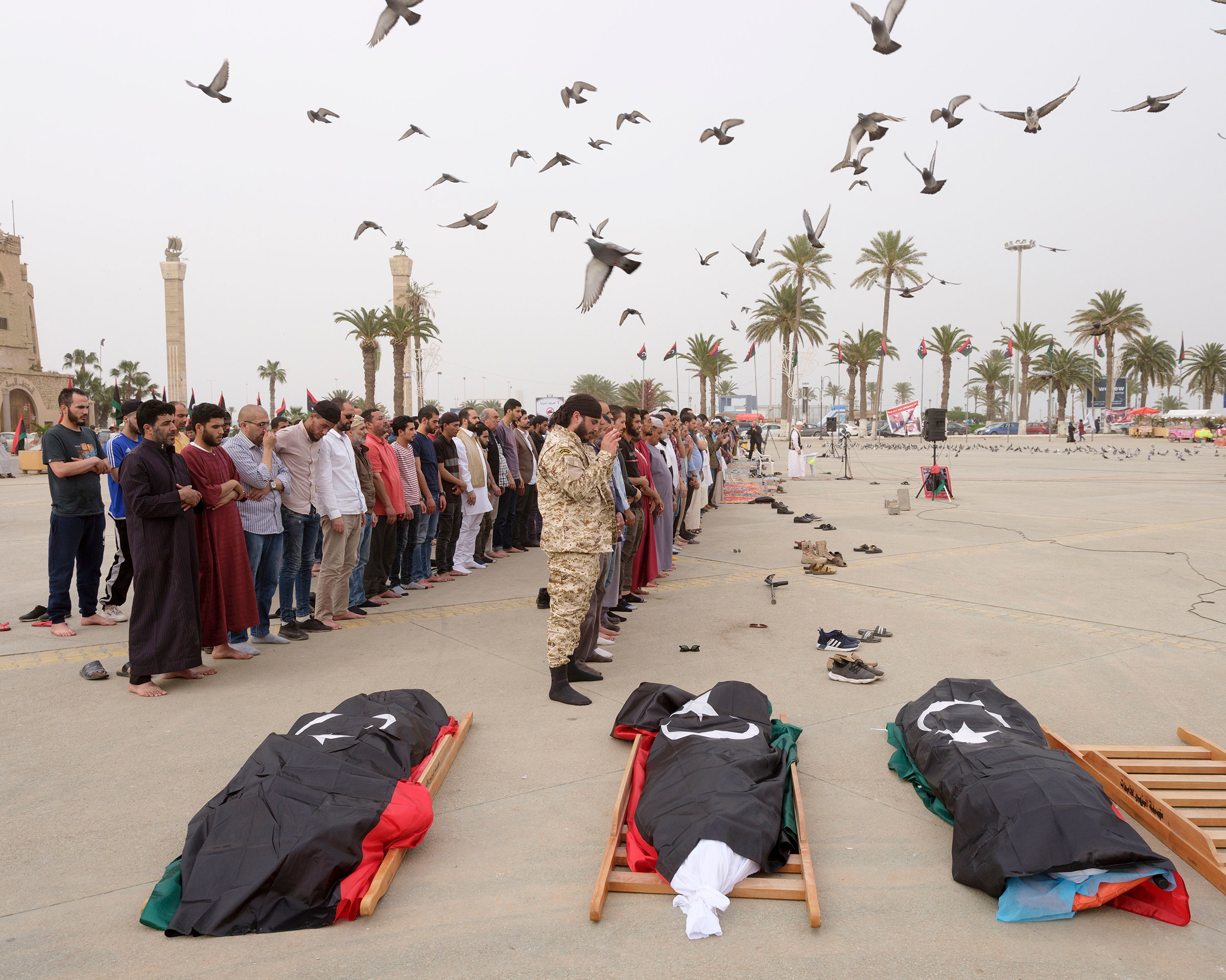 A funeral is held for three GNA fighters in Martyrs' Square in April.