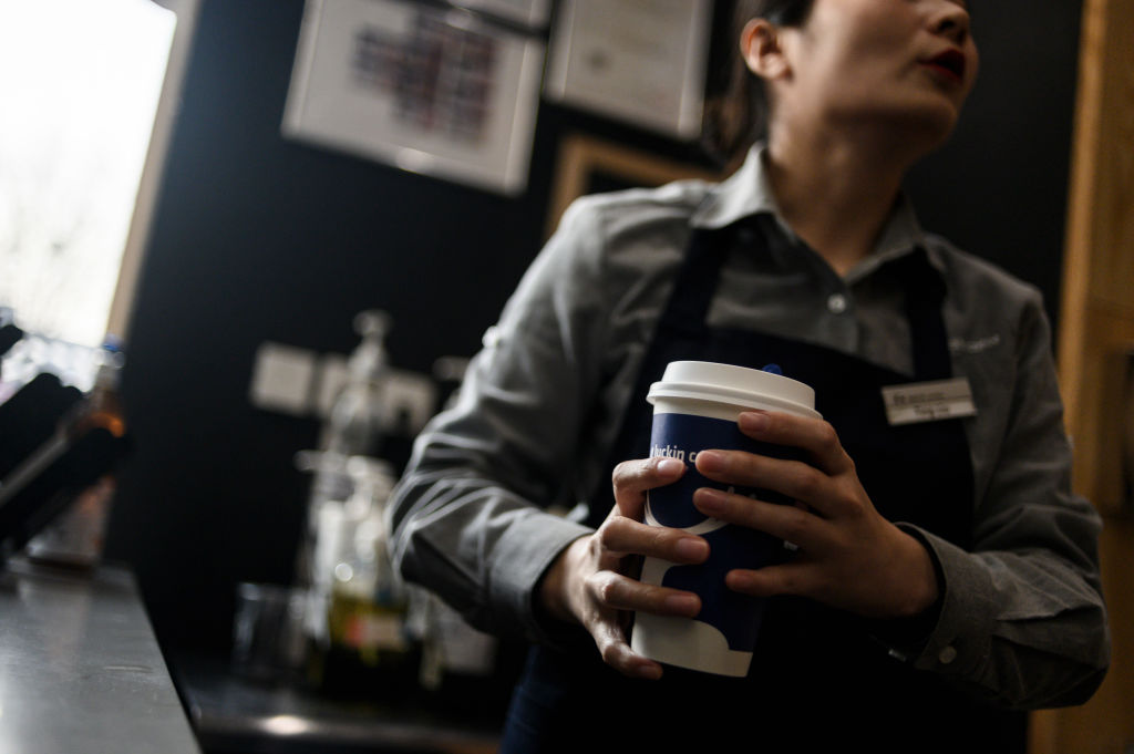 A waitress prepares coffee at a Luckin Coffee on January 14, 2019.