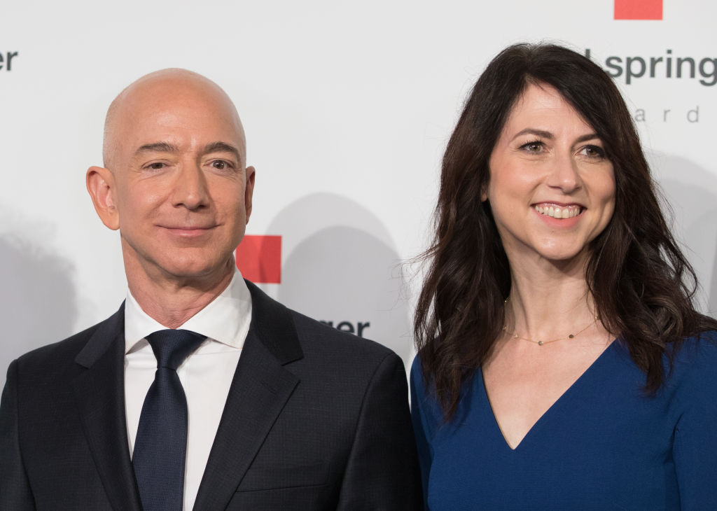 Head of Amazon Jeff Bezos and his wife MacKenzie Bezos arrive for the Axel Springer award ceremony on April 24, 2018 in Berlin, Germany.