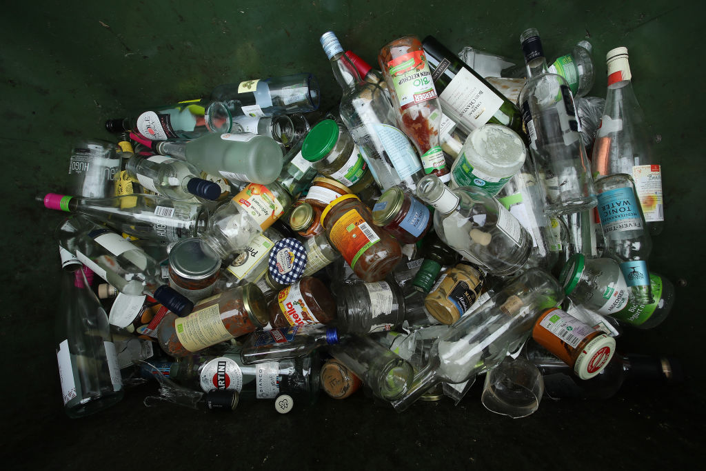 Clear glass bottles and jars lie in a recycling bin in Berlin, Germany on Aug. 20, 2018.
