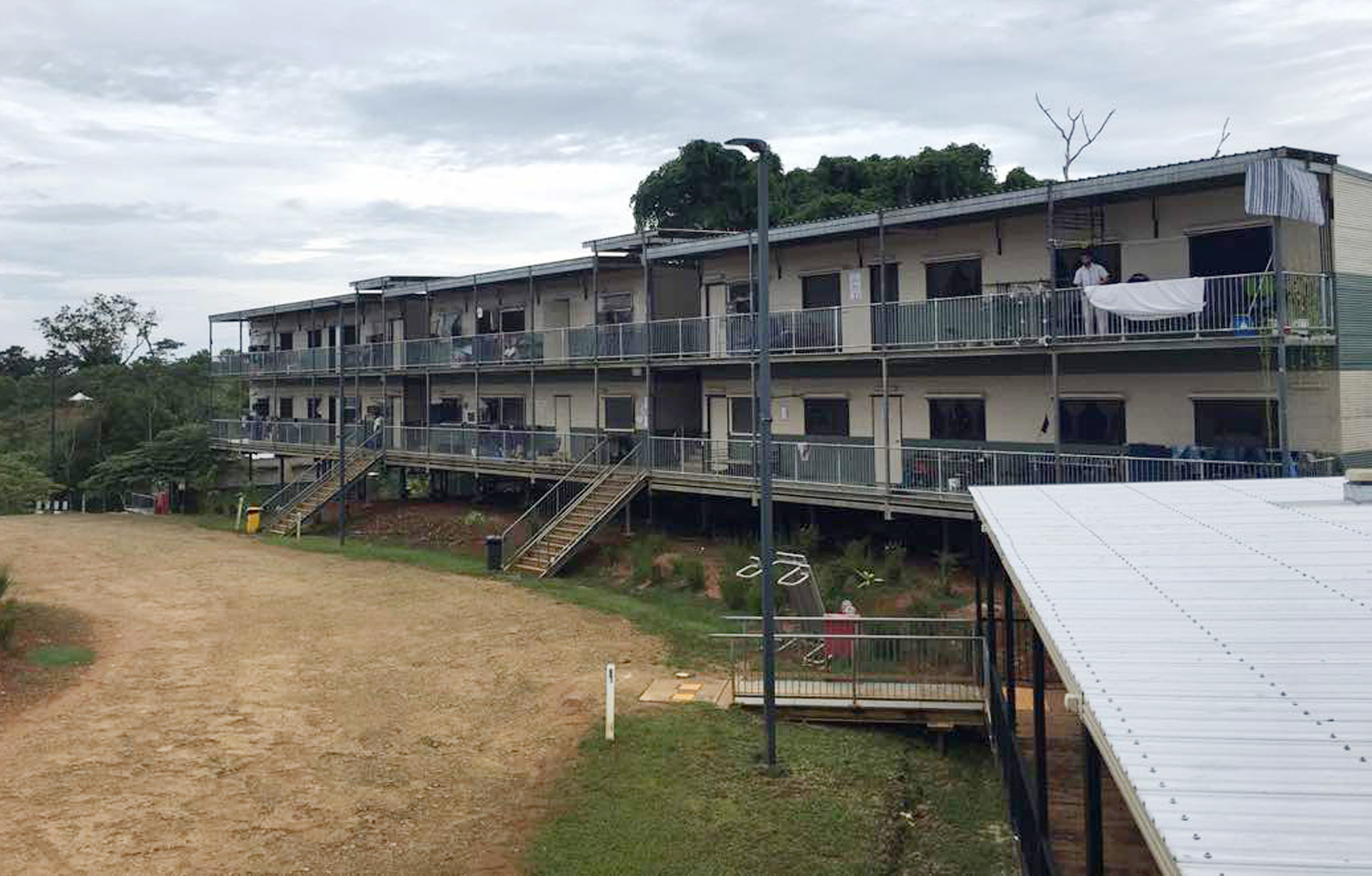 A man standing on a balcony at the East Lorengau Refugee Transit Center on Manus Island, Papua New Guinea on July 17, 2018.