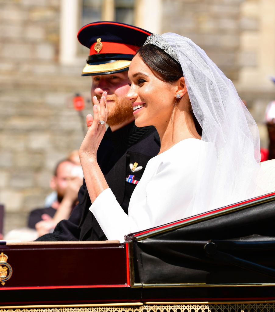 Prince Harry, Duke of Sussex and Meghan, Duchess of Sussex leave Windsor Castle in the Ascot Landau carriage during the procession after getting married at St George's Chapel, Windsor Castle on May 19, 2018 in Windsor, England.