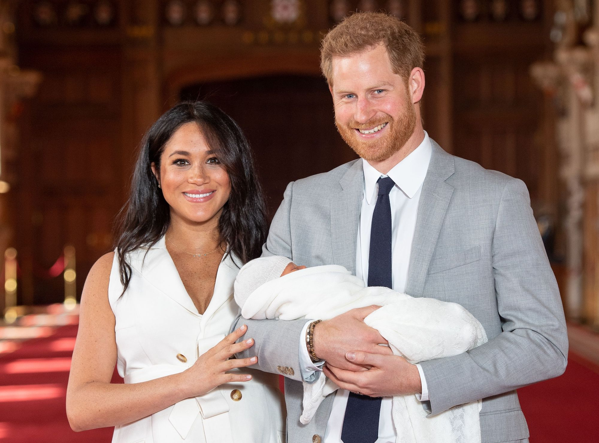 Britain's Prince Harry, Duke of Sussex, and his wife Meghan, Duchess of Sussex, pose for a photo with their newborn baby son on May 8, 2019. (Dominic Lipinski—Getty Images)