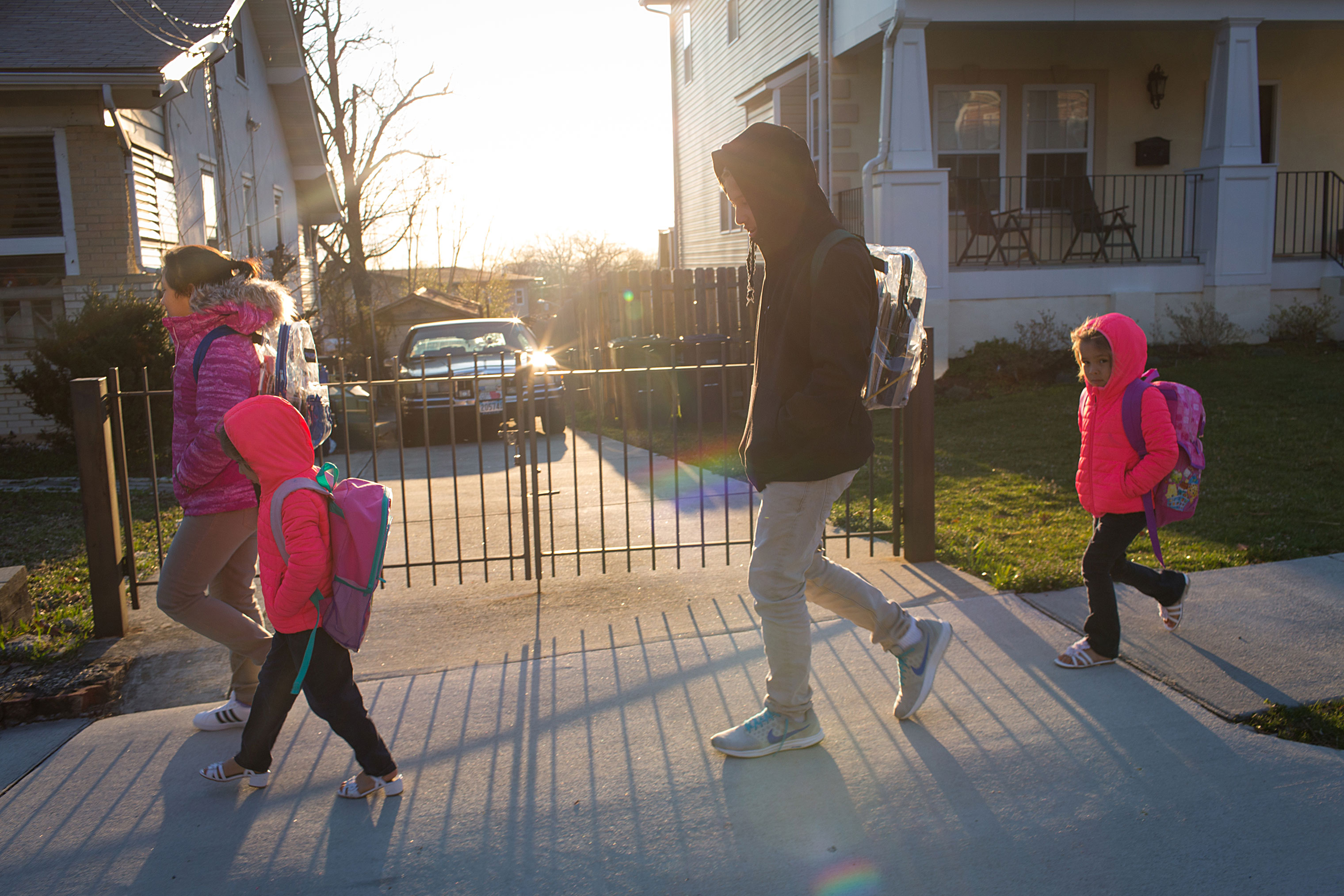 From left, Jeimy, 13, Sayra, 5, Victor, 15, and Cheyli, 5, walk to school on March 25.