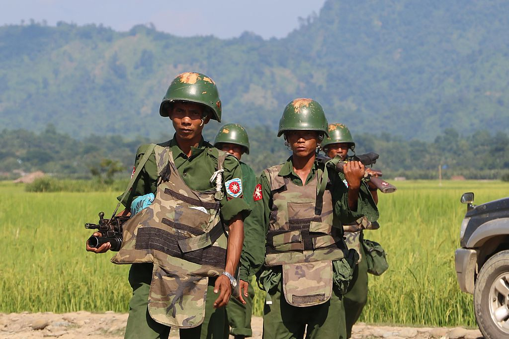 Armed Myanmar soldiers patrol a village in Maungdaw located in Myanmar's Rakhine State on Oct. 21, 2016.
