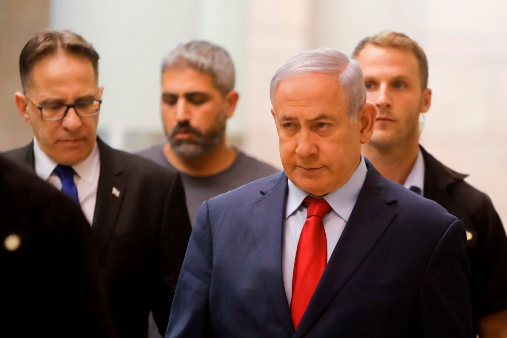Israeli Prime Minister Benjamin Netanyahu (R) walks to a party meeting in the Knesset (Israeli parliament) building in Jerusalem on May 29, 2019.