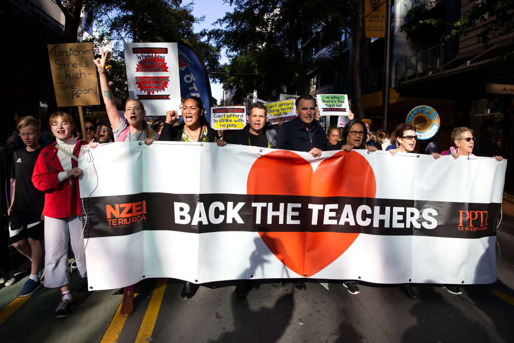 Teachers, parents and students march towards Parliament during a teachers strike in Wellington, New Zealand on May 29, 2019.
