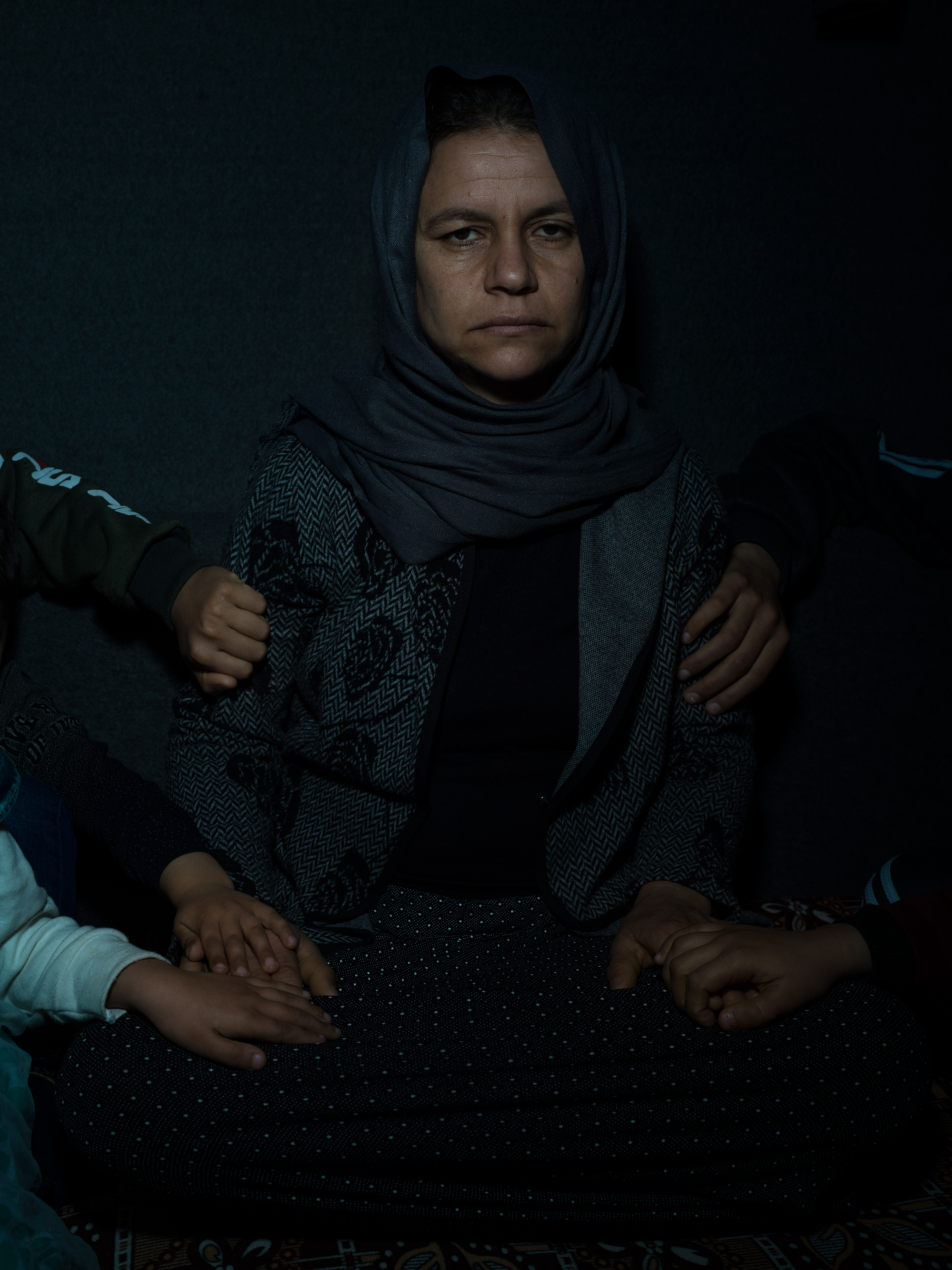 Subha, 35, and the hands of her children: Fahad, 15; Fahdi, 13; Linda, 10; Liza, 7; and Salam, 5. Photographed in February, they were captured by ISIS in 2014 and held as slaves until recently escaping the battle in Baghouz. Fahad, who had been trained as a fighter, led the way to safety.