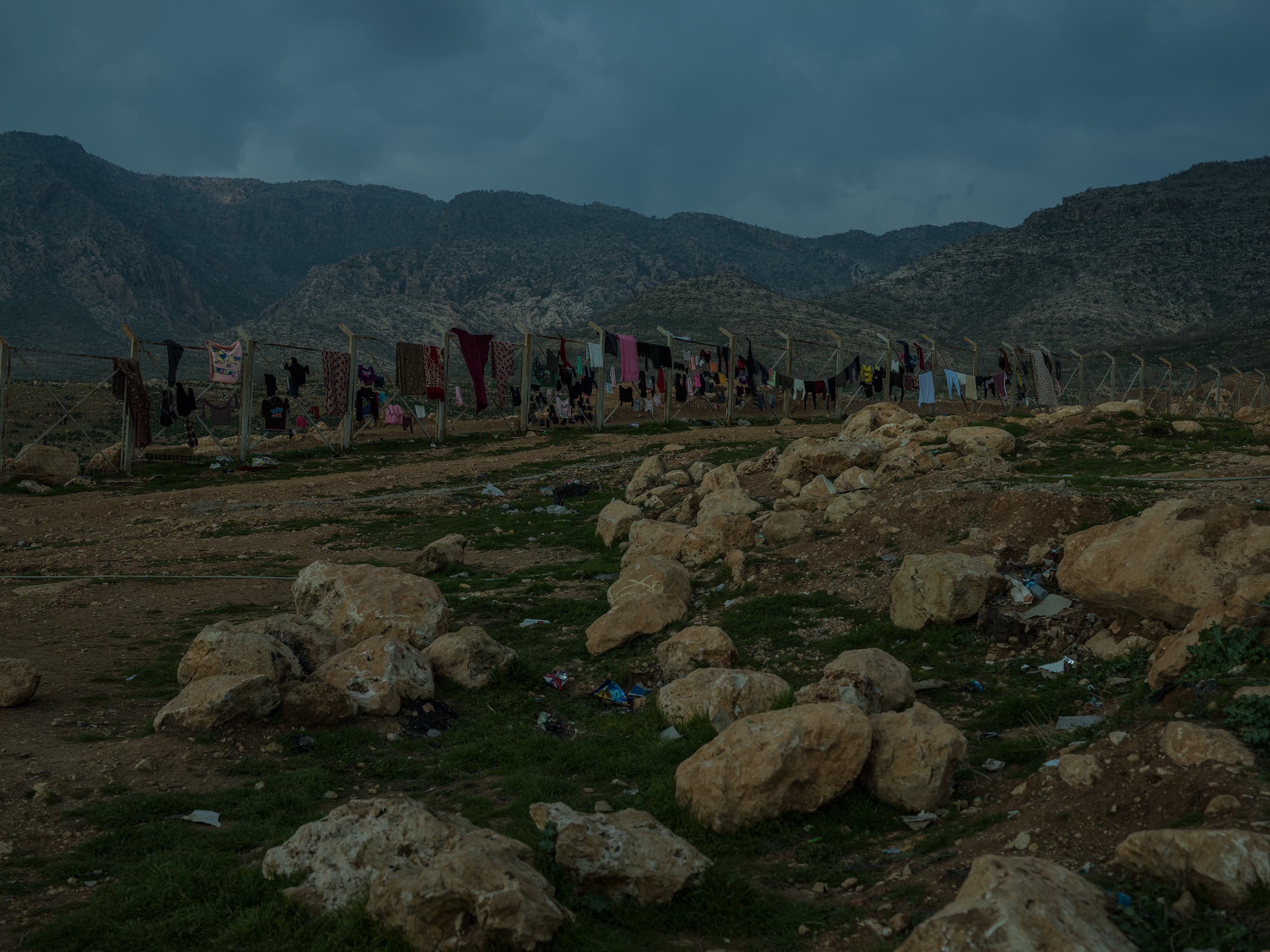 Clothes dry on a fence at a camp for displaced Yezidis near Duhok.