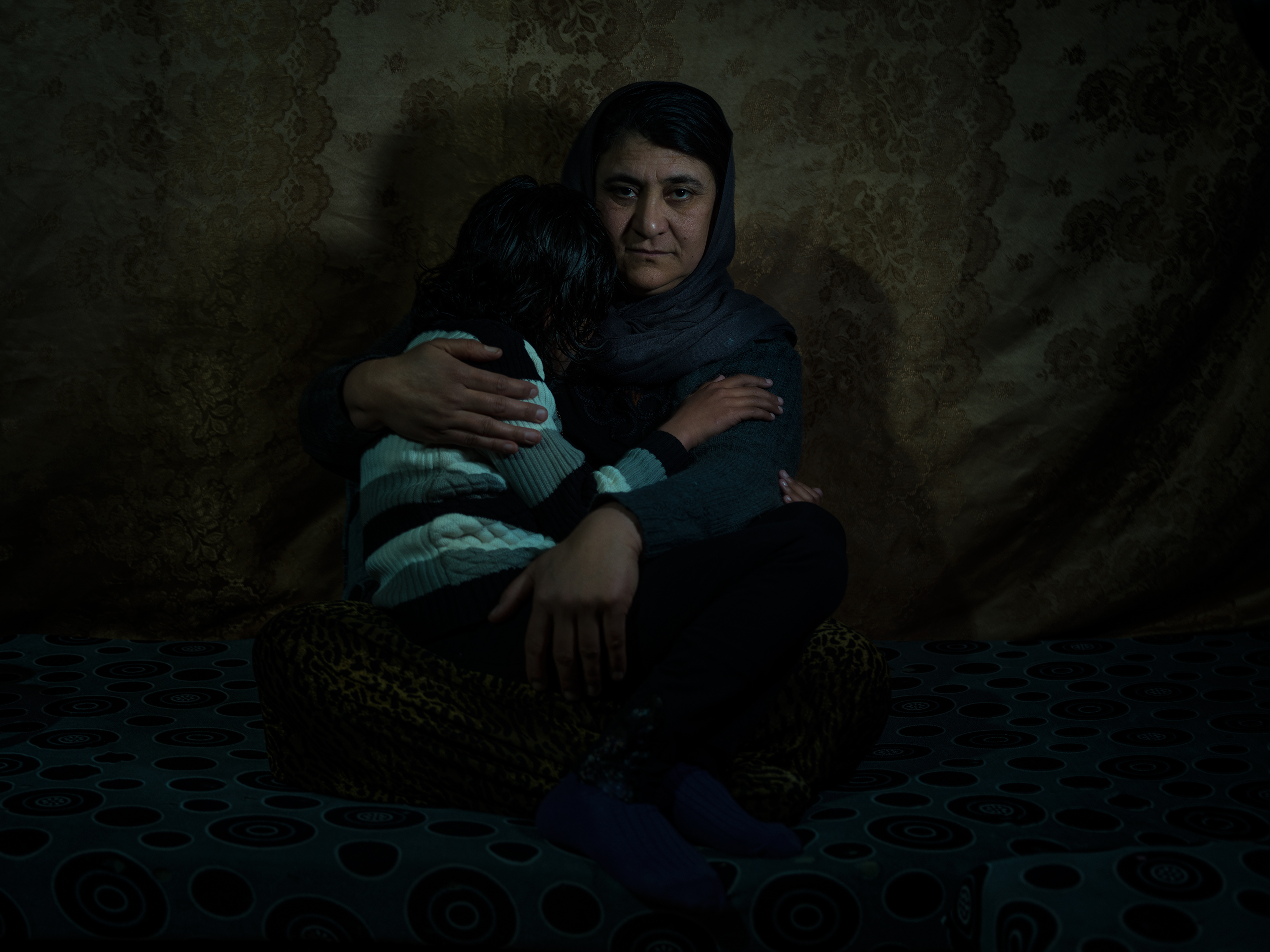 Sairan Khalaf speaks Kurdish; her daughter, 11, knows only Arabic after three years of captivity.
