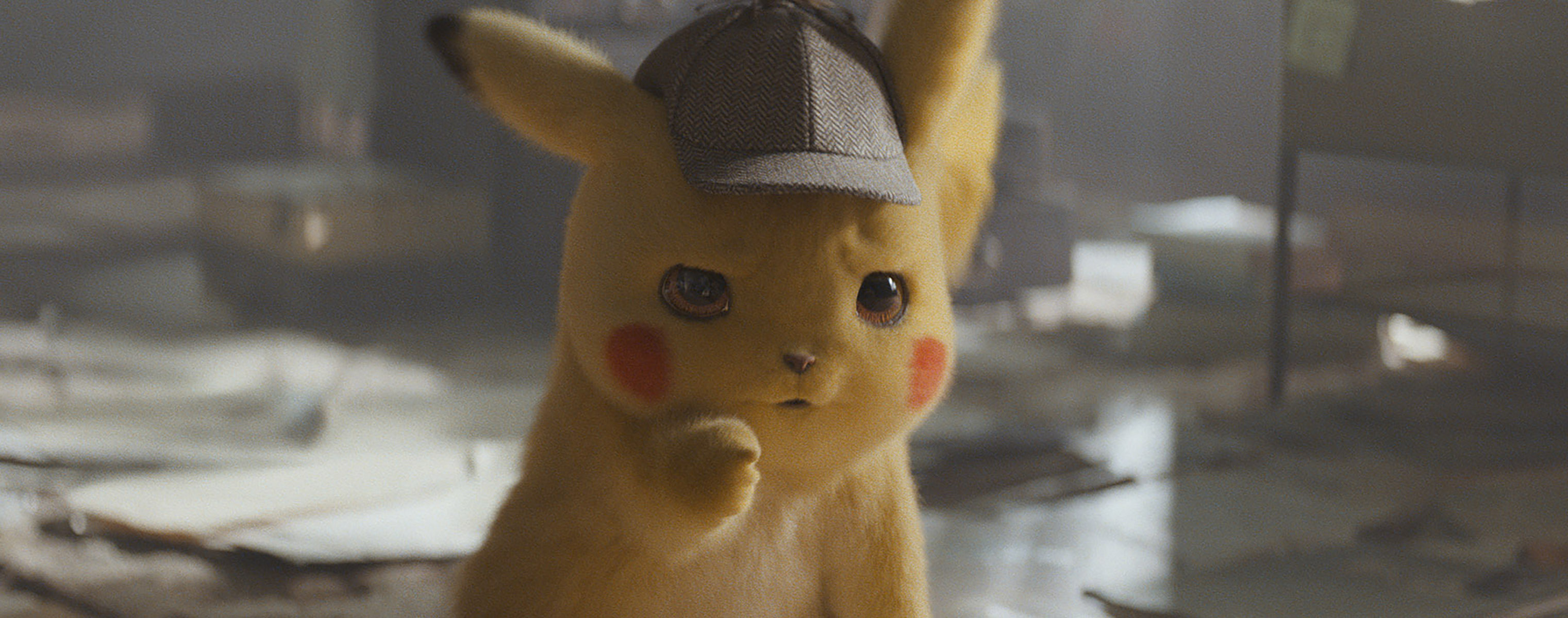 The title character in  Detective Pikachu  (voiced by Ryan Reynolds)
