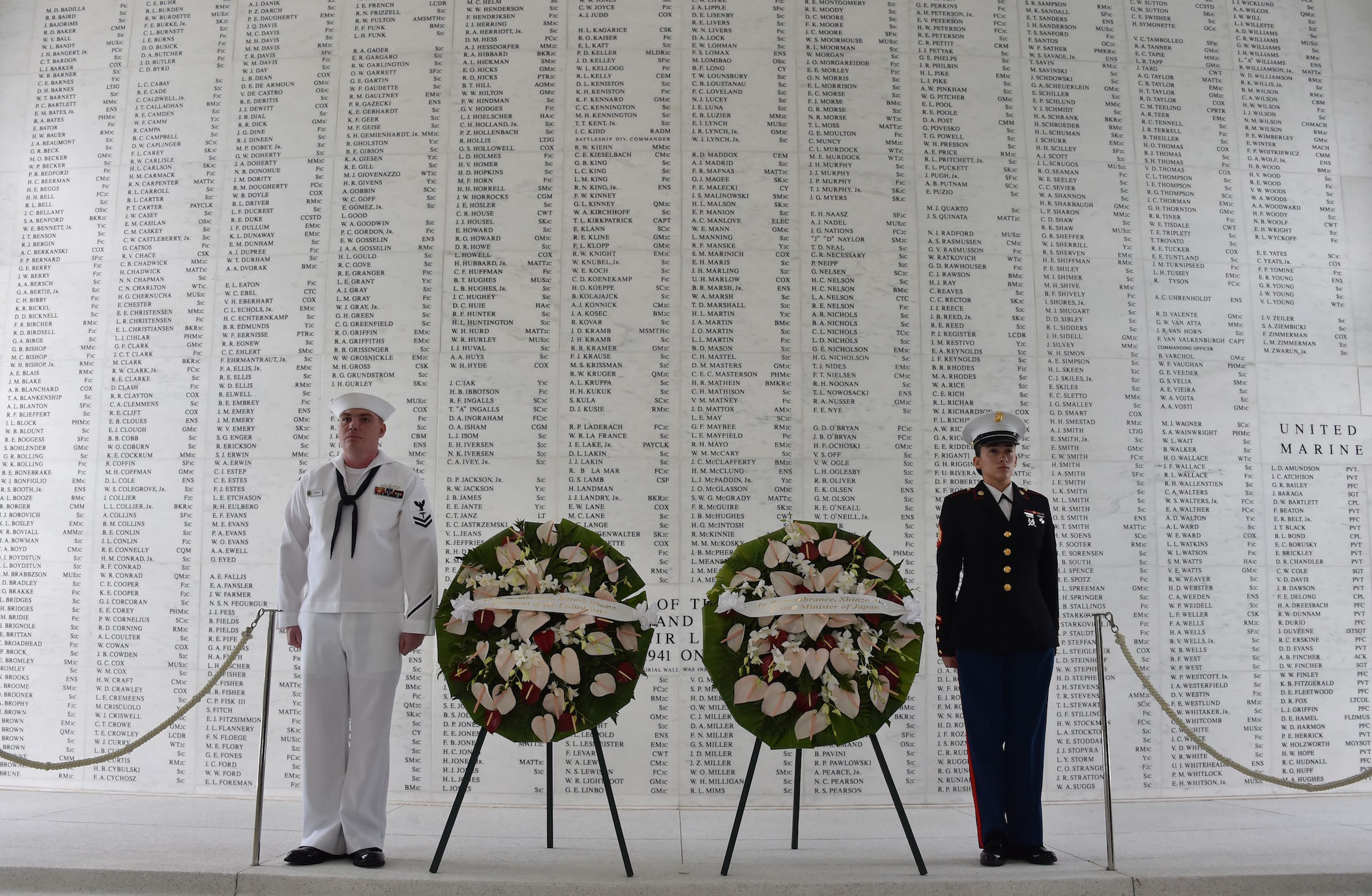 Two members of the U.S. military stand at attention after U.S. President Barack Obama and Japanese Prime Minister Shinzo Abe laid wreaths at the USS Arizona Memorial on Dec. 27, 2016 at Pearl Harbor in Honolulu.