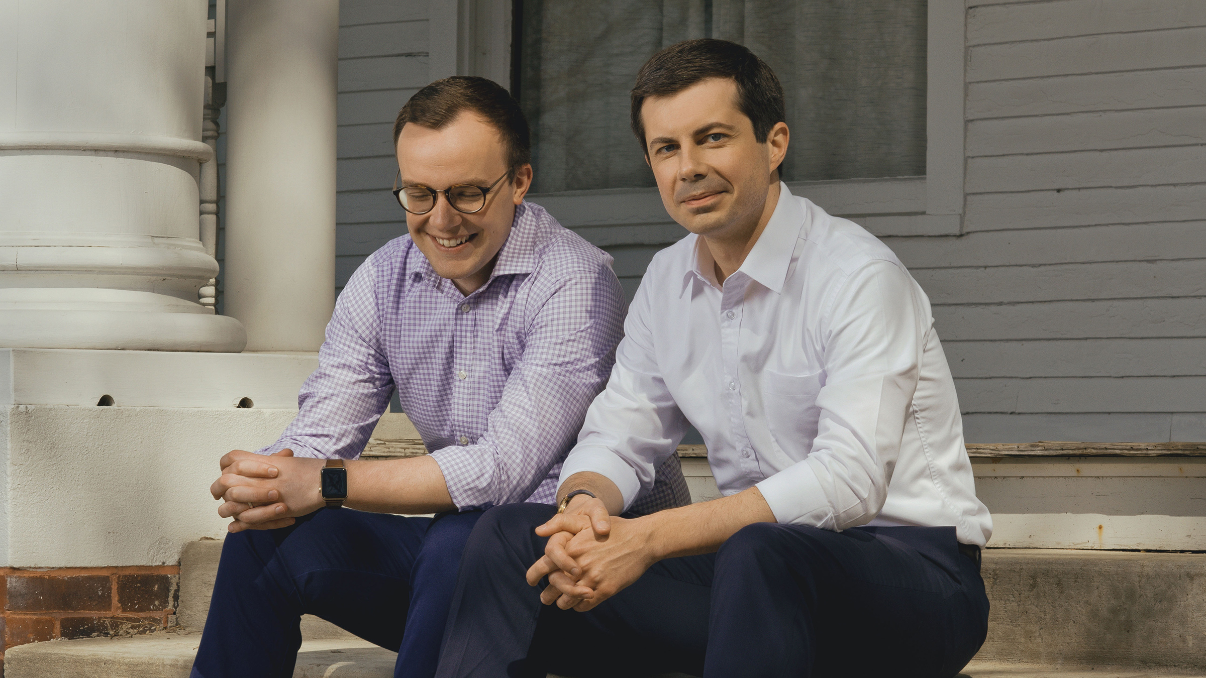 Chasten Glezman and Mayor Pete Buttigieg on the front steps of their home in South Bend, Ind.
