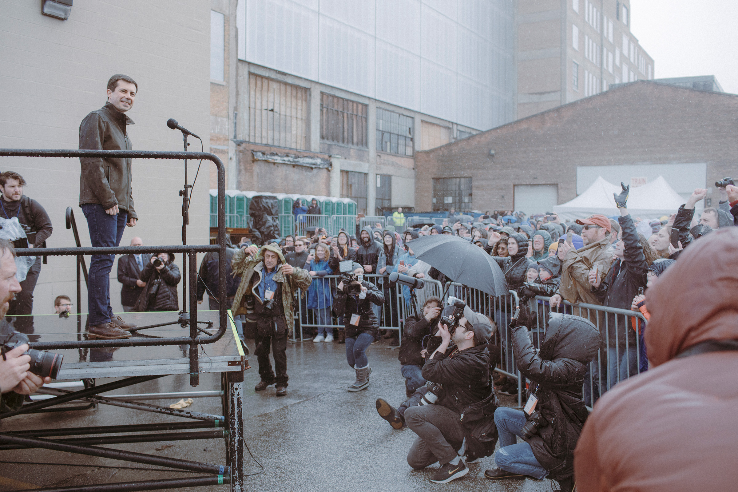 Mayor Pete Buttigieg greets the overflow crowd of supporters waiting in the rain on April 14 outside his presidential campaign announcement in South Bend.