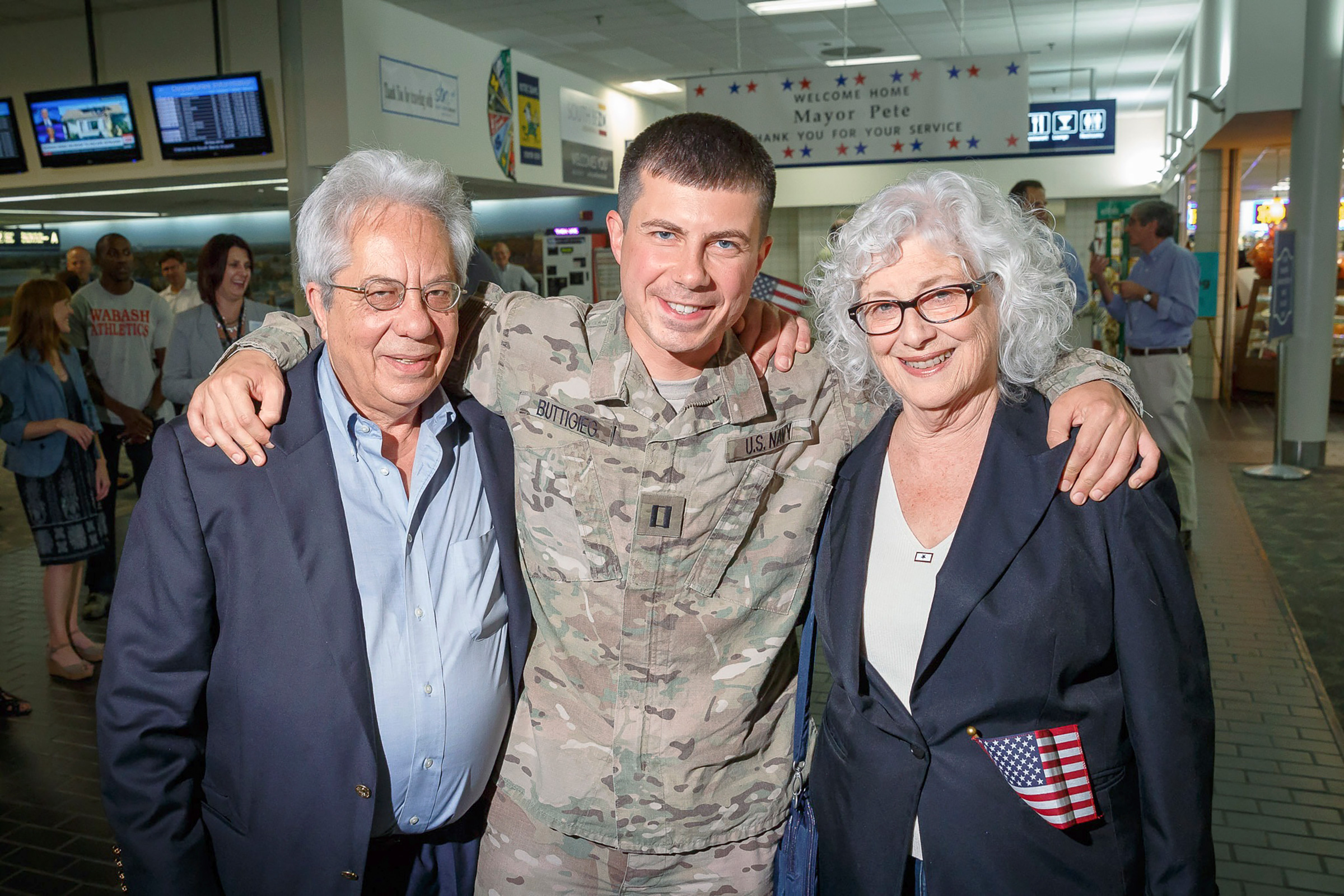 Lieutenant Buttigieg with his parents Joseph and Anne when he returned to South Bend after six months in Afghanistan, 2014.