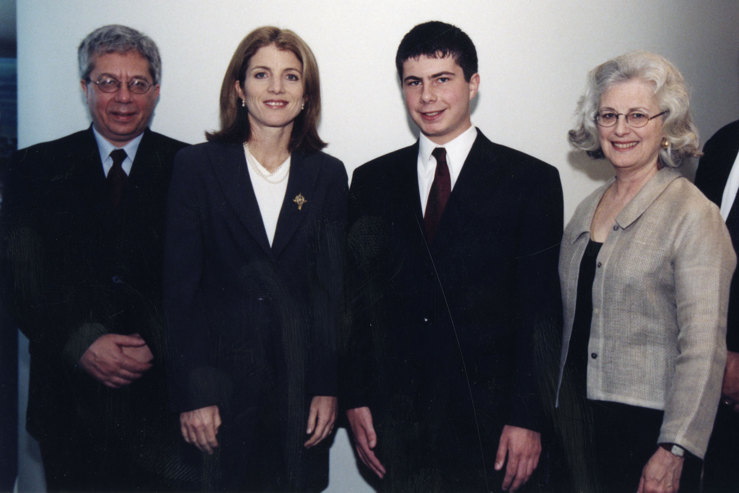 Buttigieg and his parents pose with Caroline Kennedy at the JFK Library in 2000. His high school essay on Senator Bernie Sanders won first place in the JFK Profiles in Courage contest.