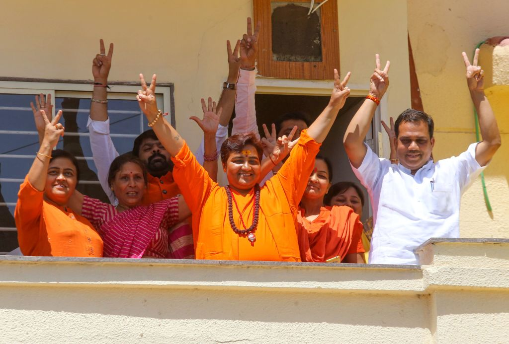 Indian Bharatiya Janata Party (BJP) candidate Pragya Singh Thakur, known as Sadhvi Pragya, gestures along with other BPJ supporters on the vote results day for India's general election at her residence in Bhopal on May 23, 2019.