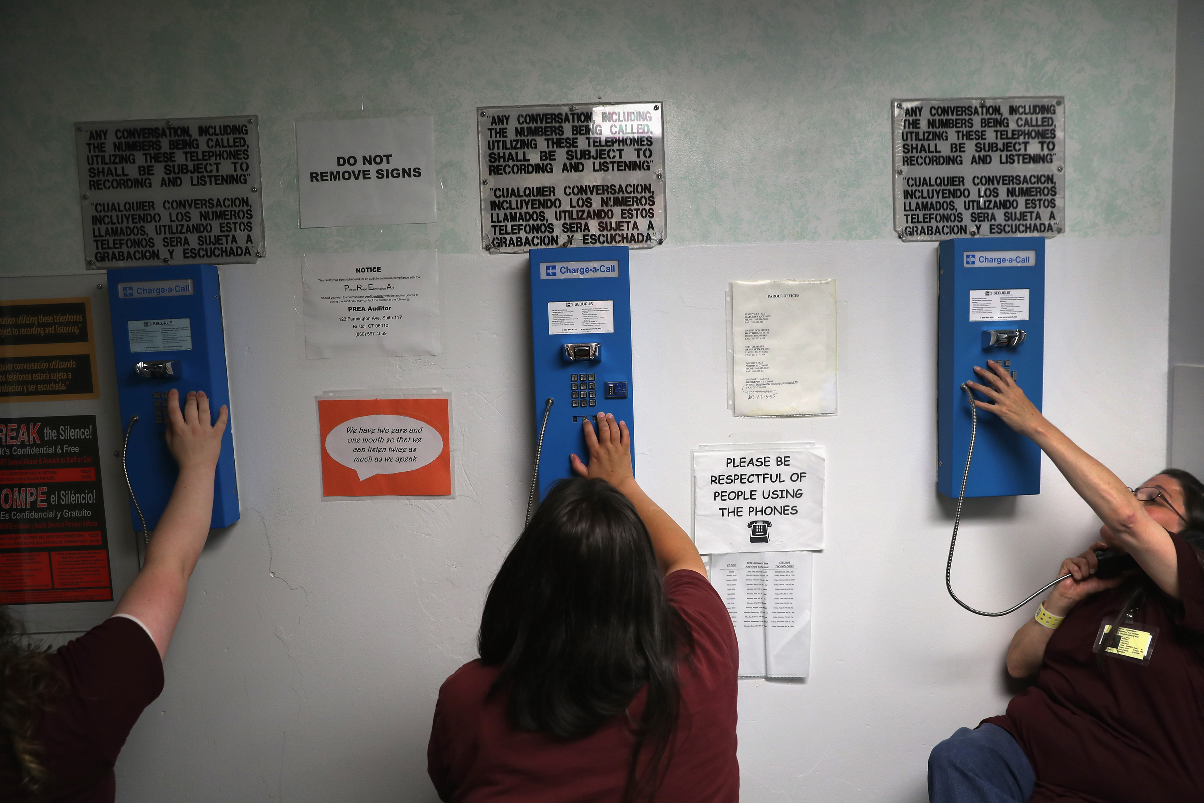Prison inmates make one of their daily allotment of six phone calls at the York Community Reintegration Center on May 24, 2016, in Niantic, Connecticut.