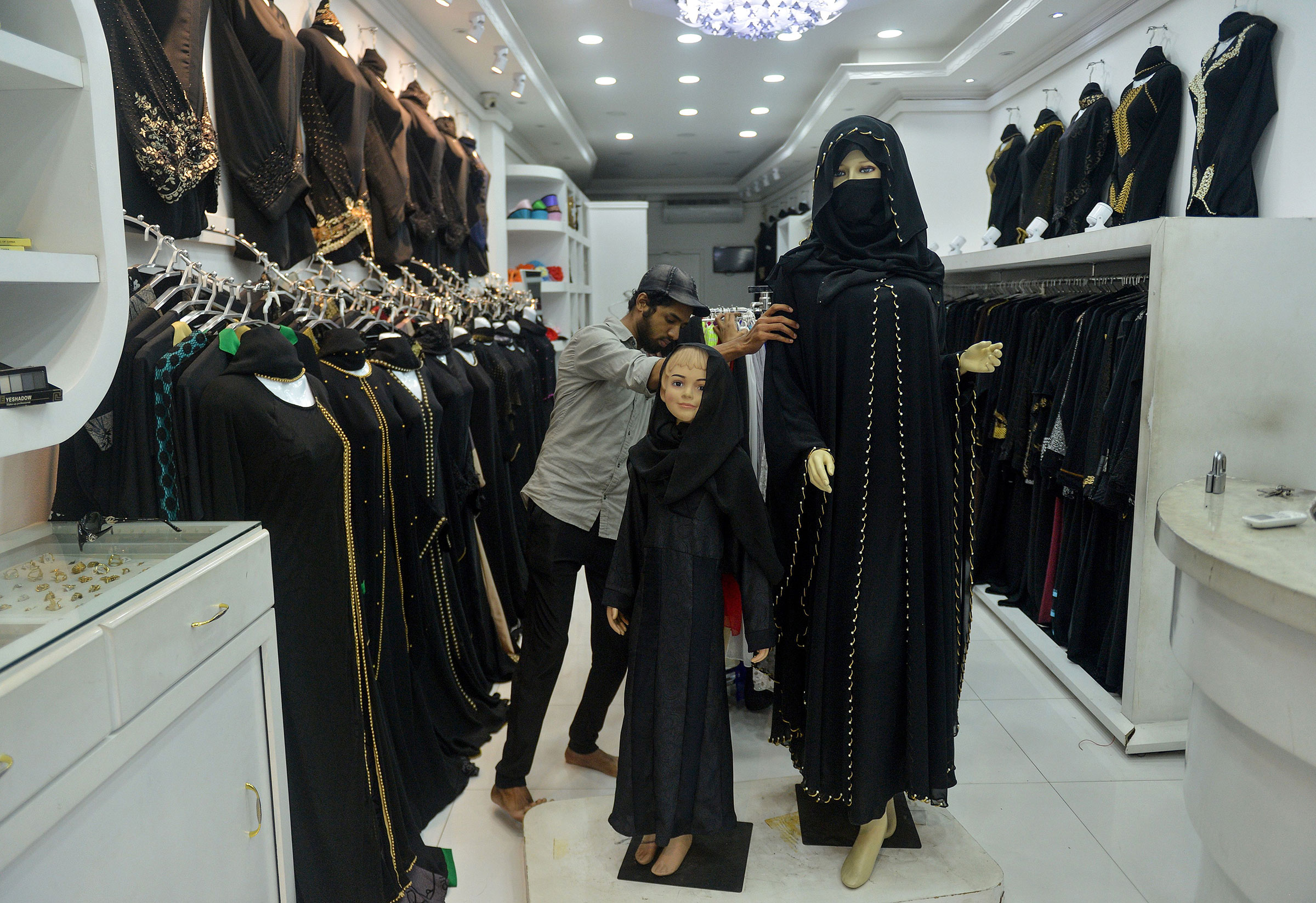 A Sri Lankan vendor shows a full face veil, called a niqab, at a shop selling clothes for Muslim women in Colombo on April 30, 2019. Religious tensions and a government ban on covering the face since the Easter Sunday suicide attacks have forced conservative Muslim women in Sri Lanka to shun veils, head scarves and long robes in public.