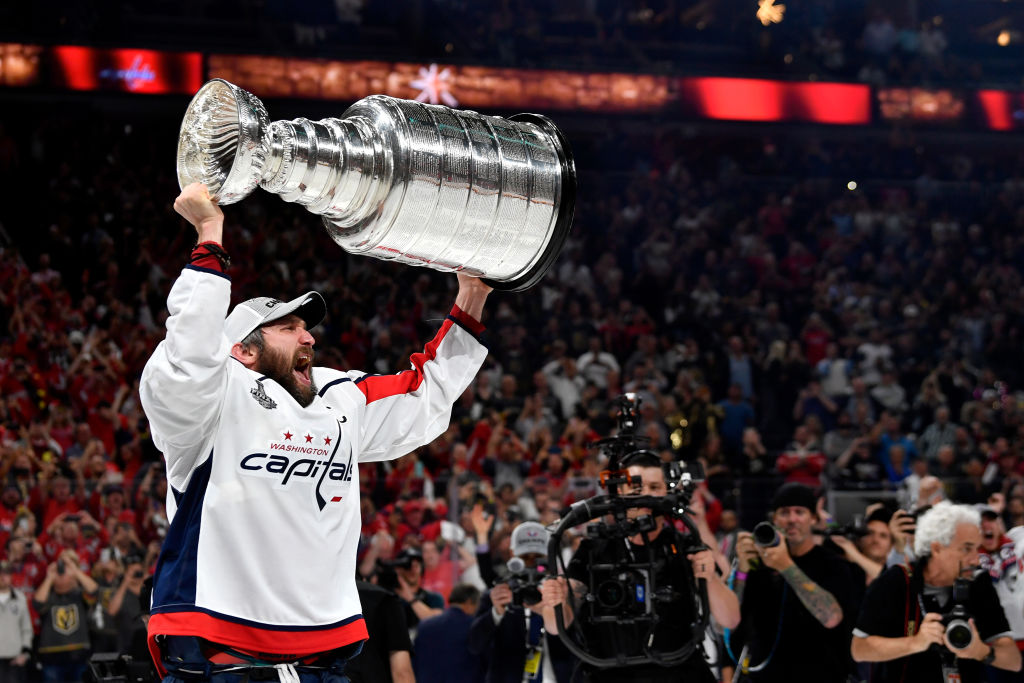 Alex Ovechkin #8 of the Washington Capitals celebrates with the Stanley Cup after defeating the Vegas Golden Knights in Game Five of the Stanley Cup Final during the 2018 NHL Stanley Cup Playoffs at T-Mobile Arena on June 7, 2018 in Las Vegas, Nevada.