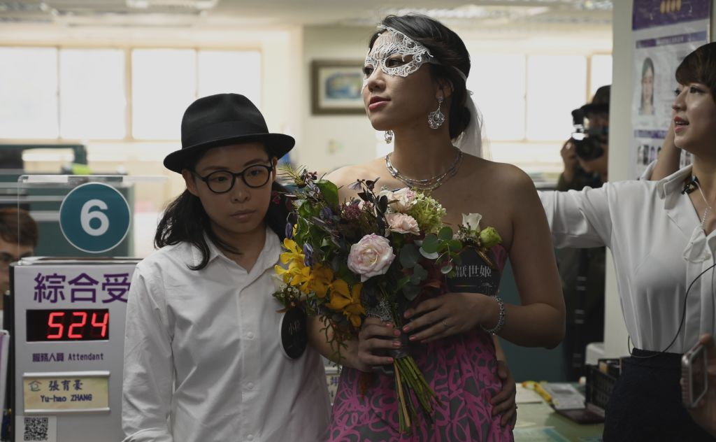 Gay couple Cynical Chick (L) and Li Ying-Chien wait for wedding register at the Household Registration Office in Shinyi district in Taipei on May 24, 2019.