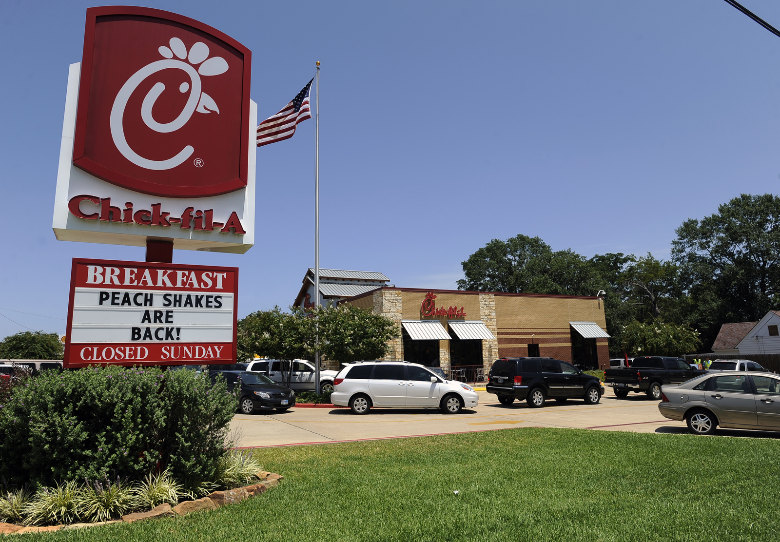 Cars circle around the local Chick-fil-A restaurant Wednesday, Aug. 1, 2012, in honor of Chick-fil-A Appreciation Day in Nacogdoches, Texas.