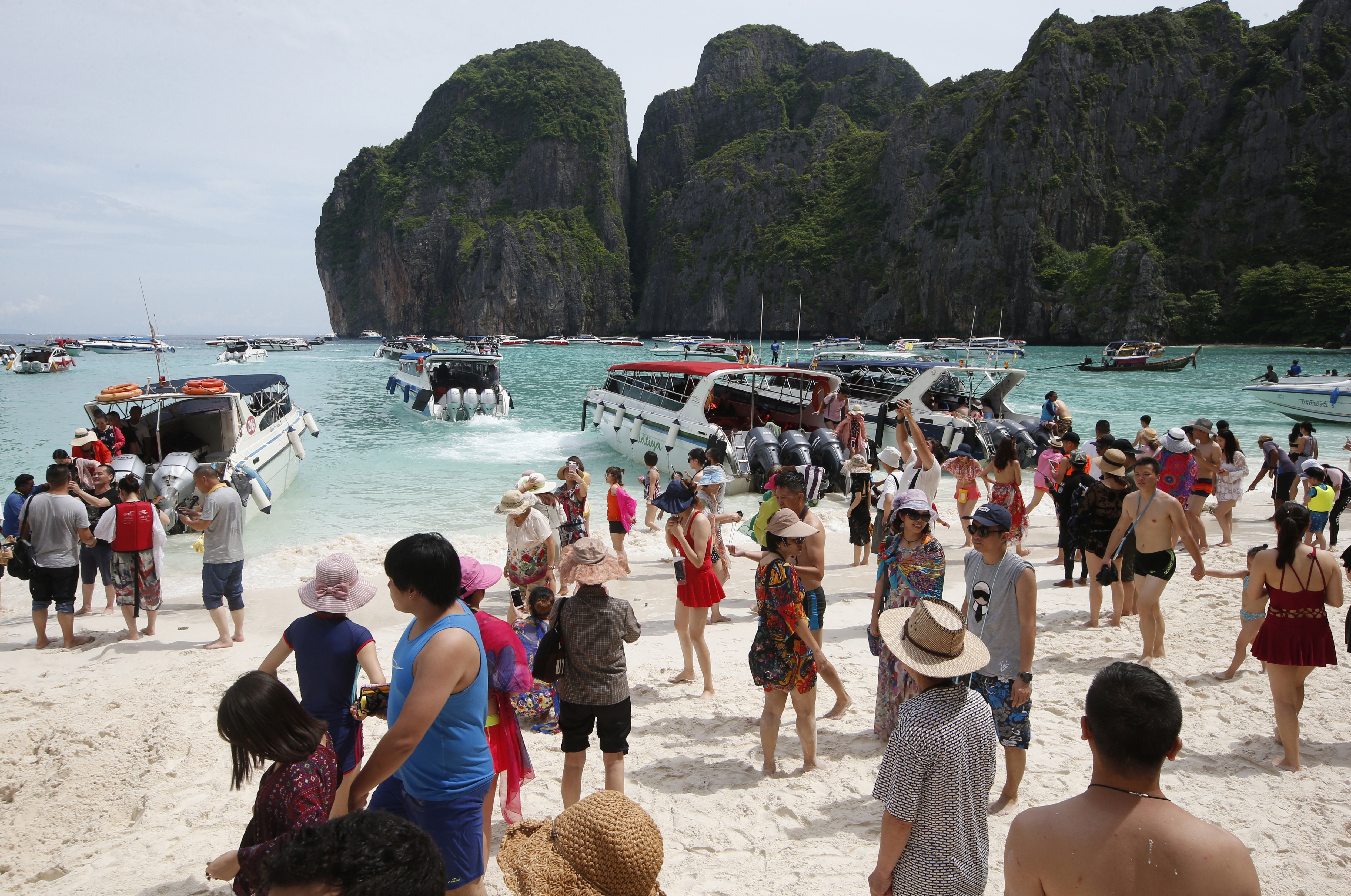 Tourists enjoy the beach on Maya Bay, Phi Phi Leh island in Krabi province, Thailand on May 31, 2018.